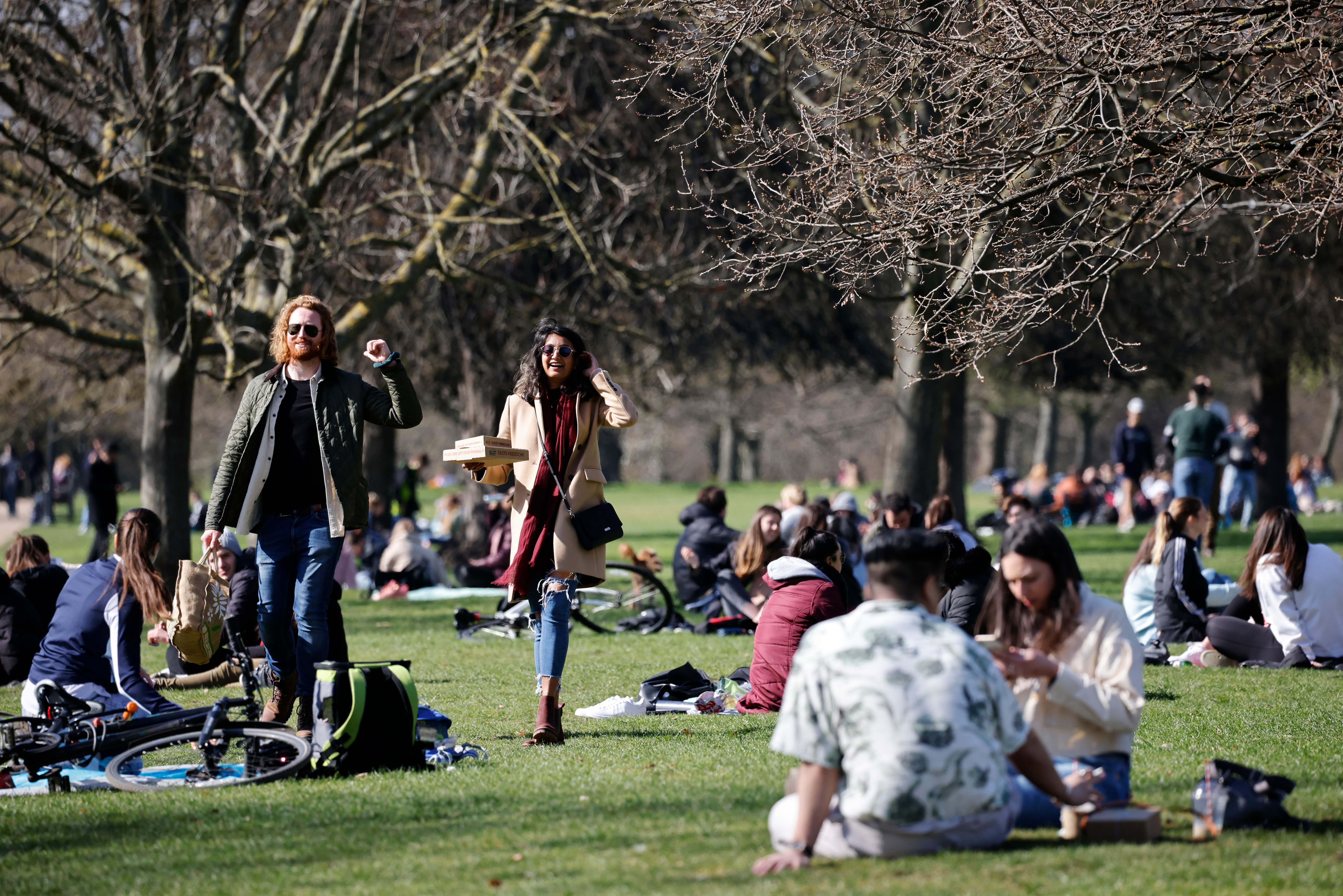 <p>in Hyde Park in central London on April 2, 2021 as life continues following an easing of the coronavirus restrictions to allow people from more than one household to meet outdoors. (Photo by Tolga Akmen / AFP) (Photo by TOLGA AKMEN/AFP via Getty Images)</p>