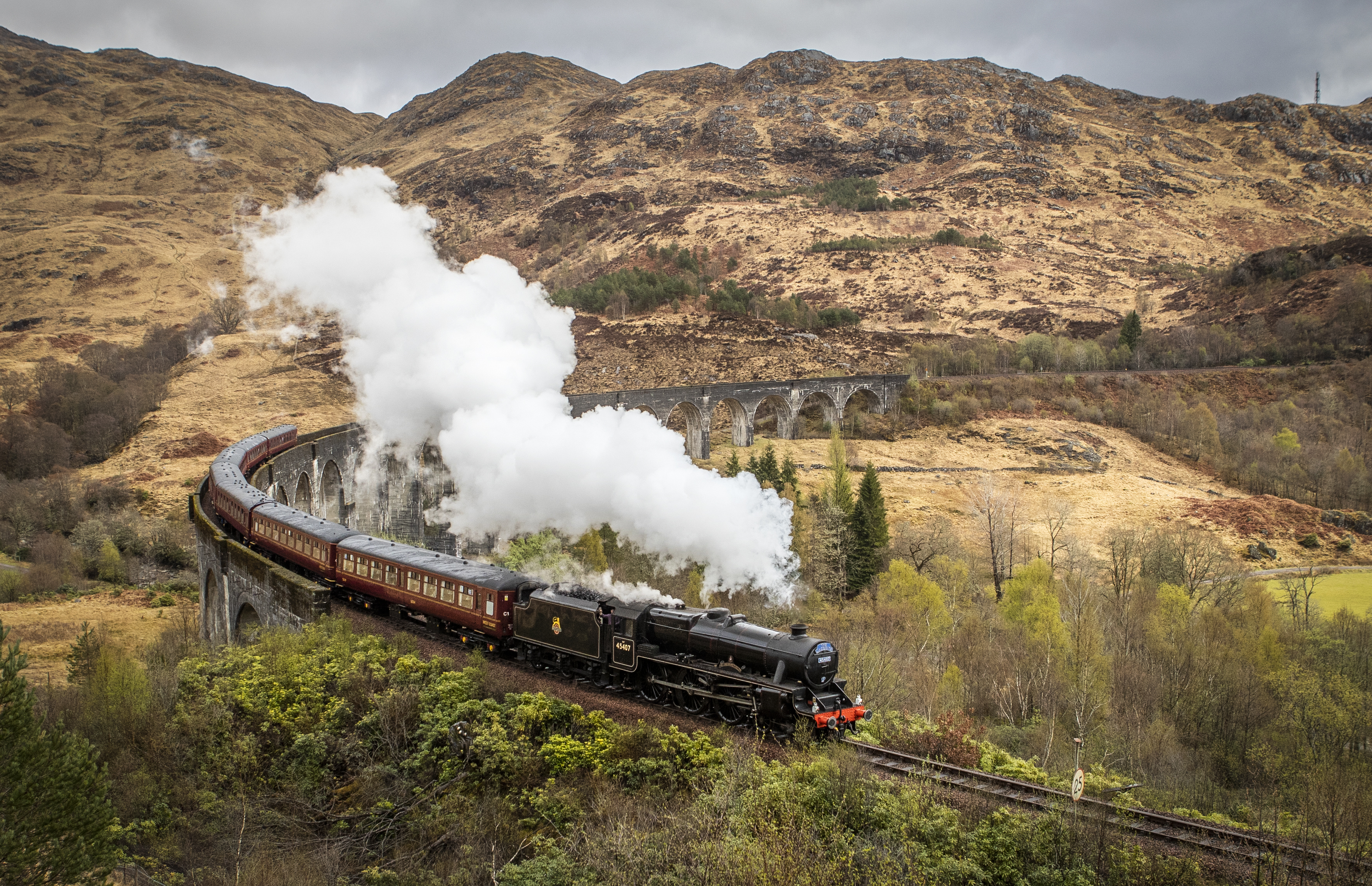 <p>The first Jacobite Express of the 2021 season crosses the Glenfinnan Viaduct on its way to Mallaig from Fort William as travel across Scotland is now permitted following the easing of coronavirus restrictions. Picture date: Monday April 26, 2021.</p>