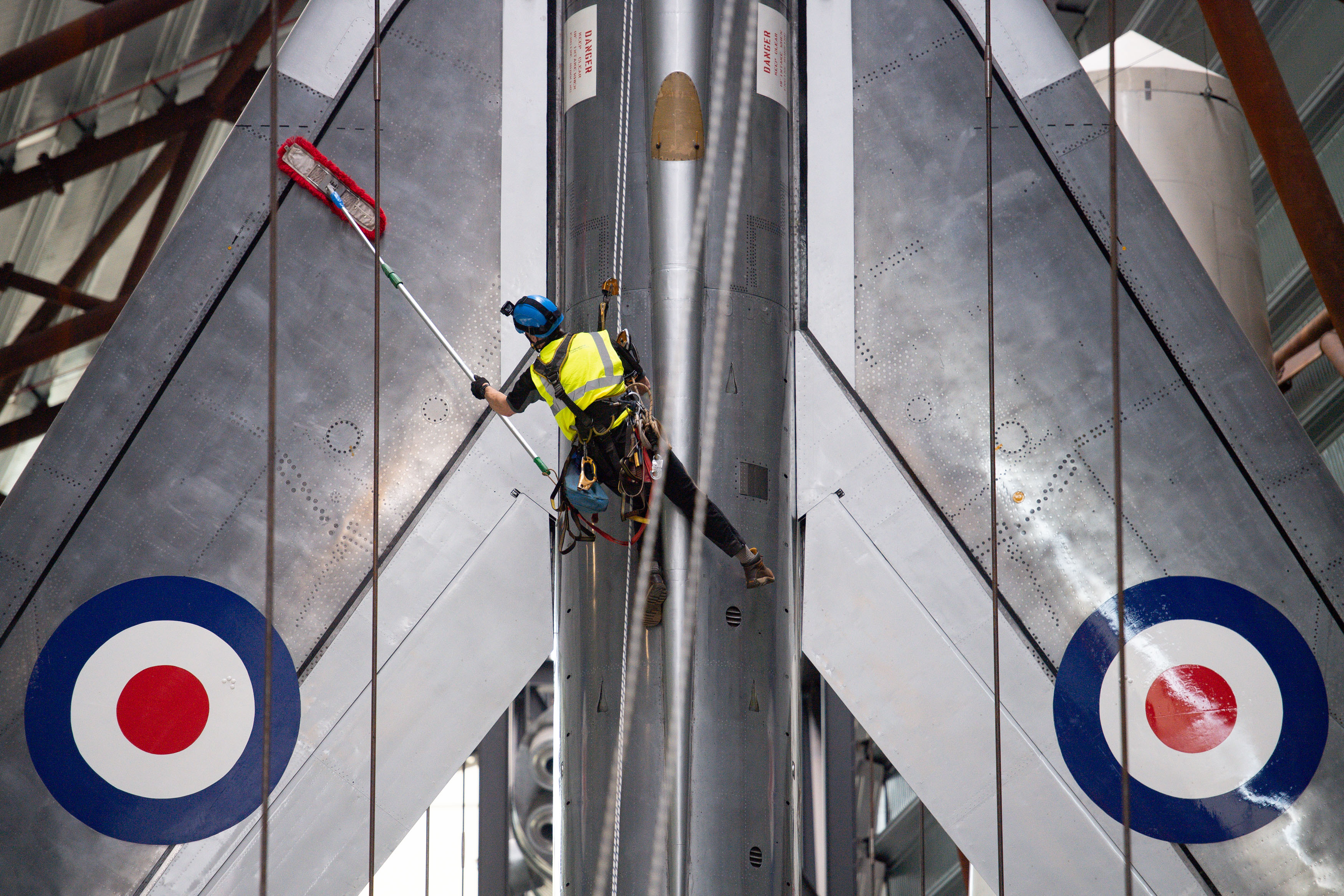 <p>Specialist operators at the Royal Air Force Museum Cosford, near Telford, Shropshire, clean the Electric Lightning aircraft displayed within the museum's National Cold War Exhibition, during annual high-level aircraft cleaning and maintenance. Picture date: Thursday April 29, 2021.</p>