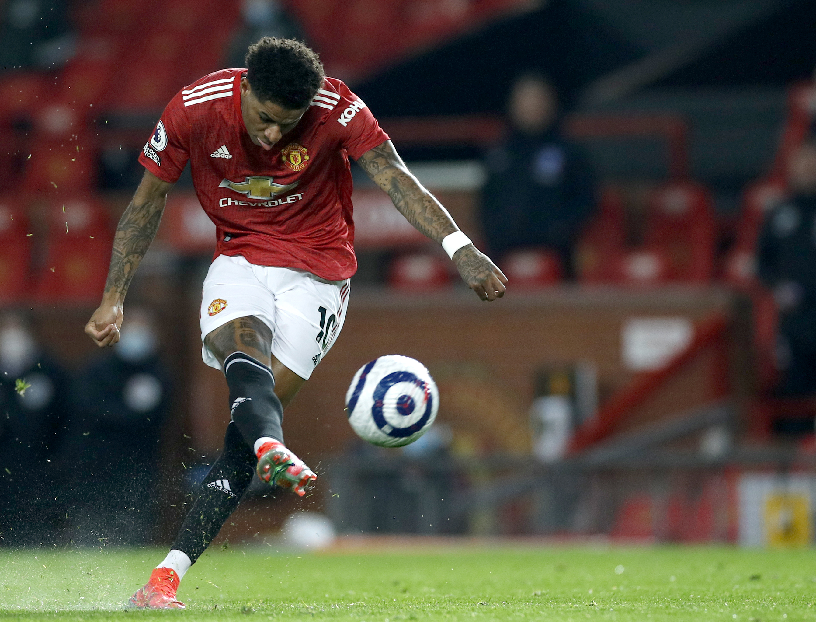<p>Manchester United's Marcus Rashford has a shot at goal during the Premier League match at Old Trafford, Manchester. Picture date: Sunday April 4, 2021.</p>