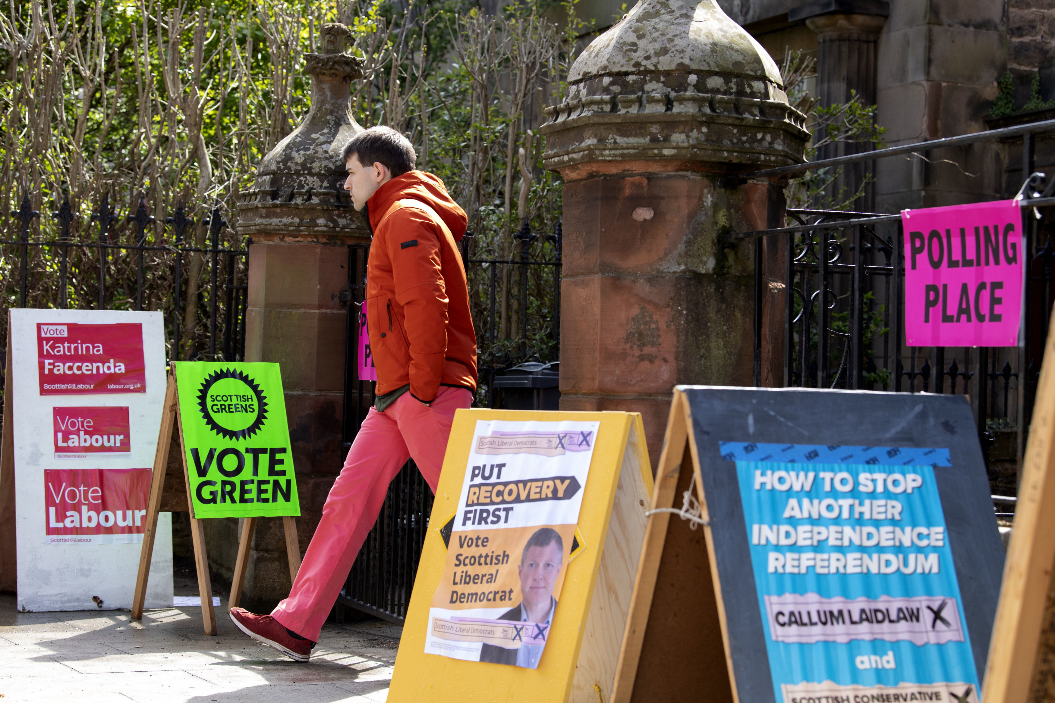 <p>A voter leaves the polling station at St James' Church in Edinburgh. Picture date: Thursday May 6, 2021.</p>