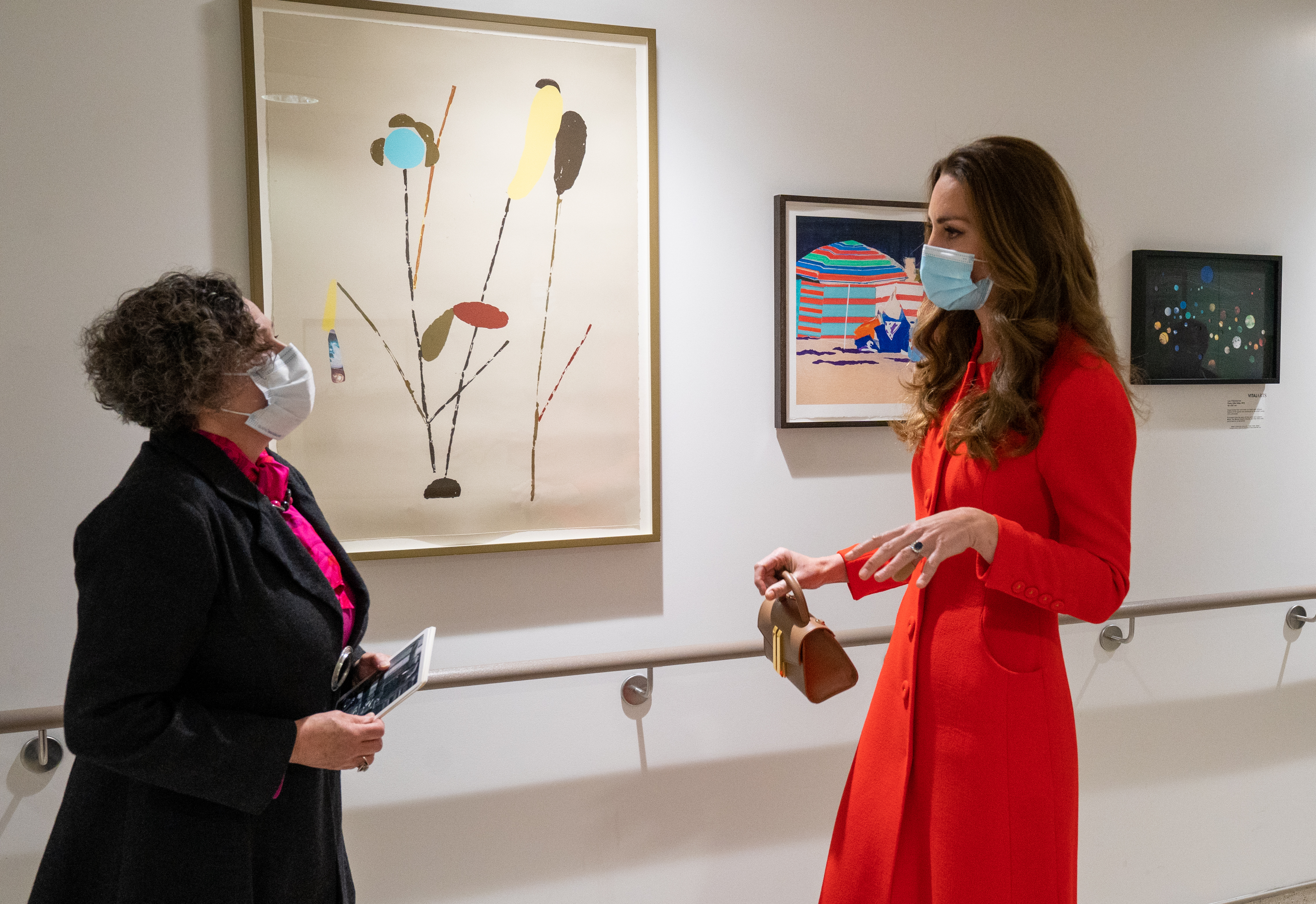 <p>The Duchess of Cambridge with Catsou Roberts, Director of Vital Arts for Barts Health NHS Trust, during a visit to the Royal London Hospital in Whitechapel, east London, to mark the publication of the Hold Still book. Picture date: Friday May 7, 2021.</p>