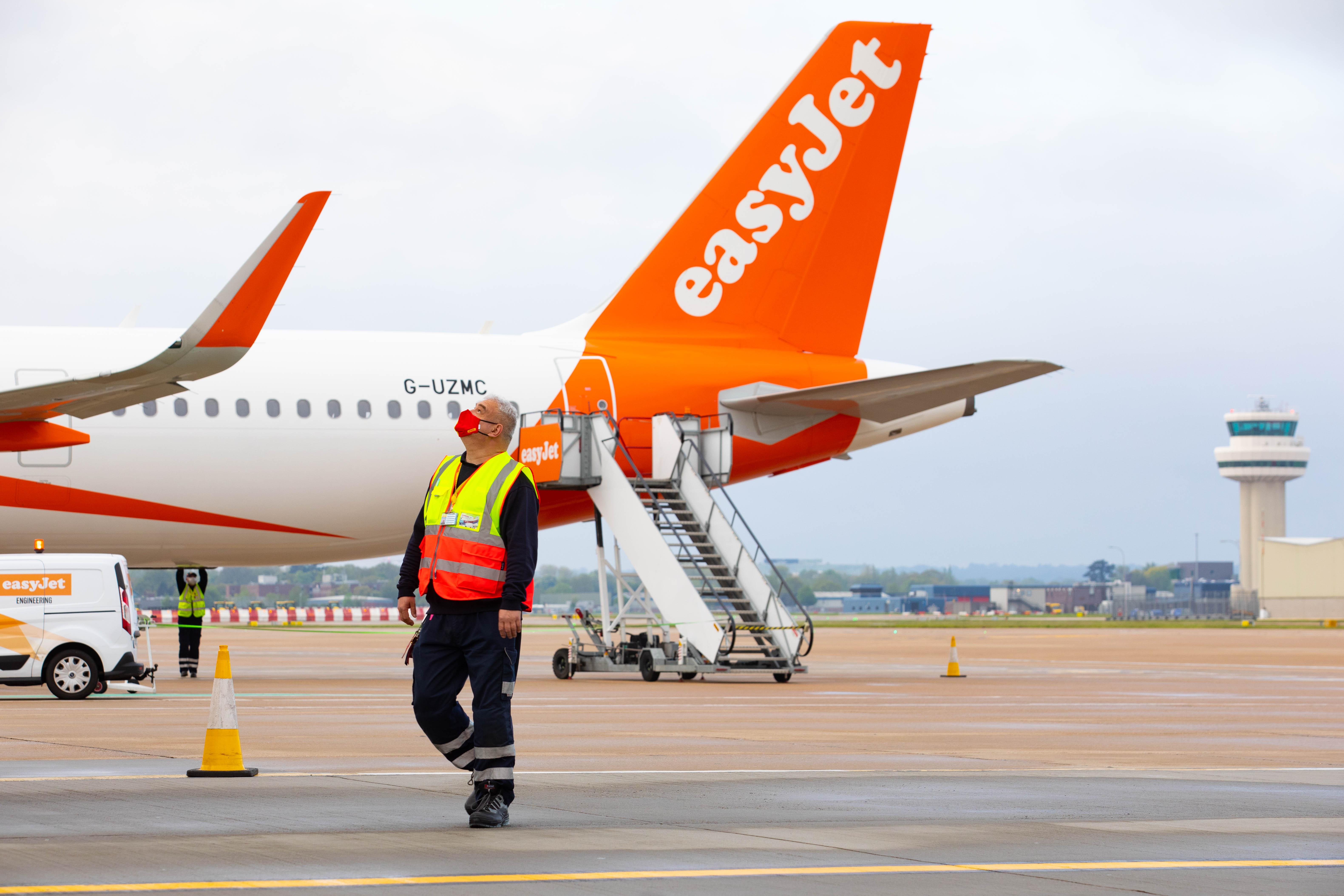 <p>EDITORIAL USE ONLY Crew prepare the first holiday and leisure flight for take-off at Gatwick Airport, as easyJet relaunch flights from the UK to green-lit destinations today, for the first time this year. Picture date: Monday May 17, 2021.</p>