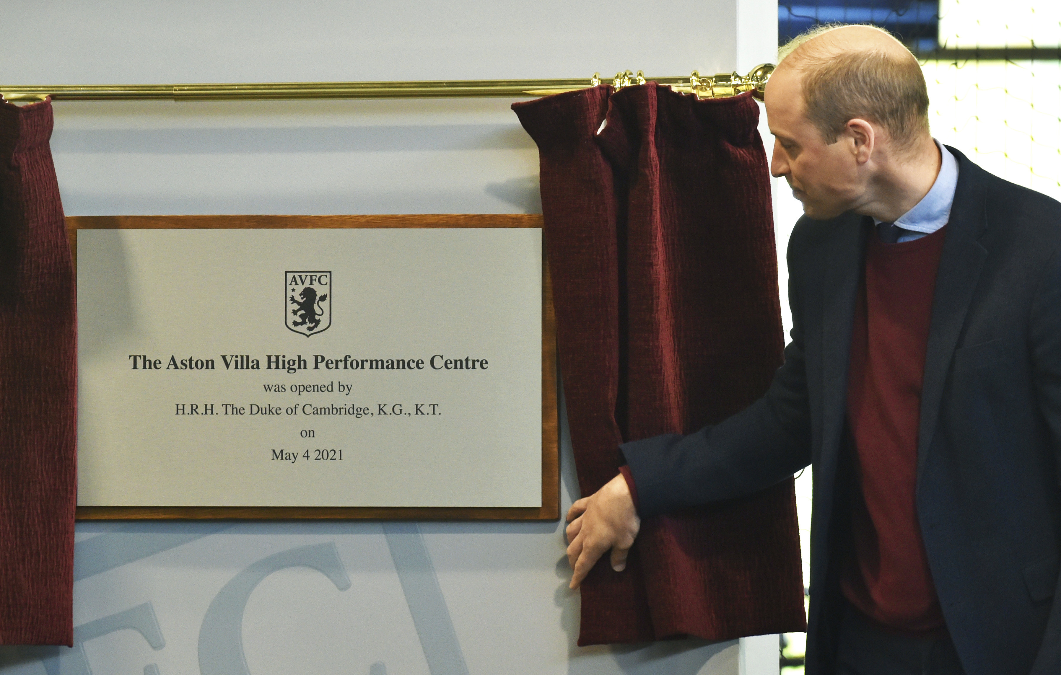 <p>Britain's Prince William, the Duke of Cambridge, unveils a plaque, during a visit to Aston Villa High Performance Centre at Bodymoor Heath Training Centre in Bodymoor Heath, England, Tuesday, May 4, 2021. (AP Photo/Rui Vieira, Pool)</p>
