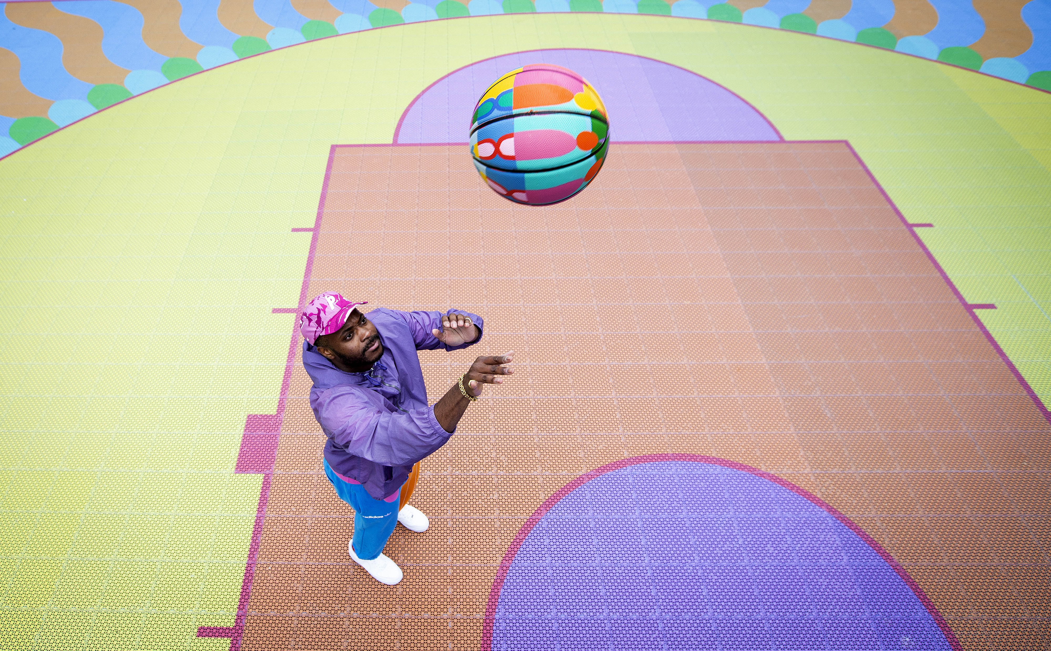 <p>EDITORIAL USE ONLY British-Nigerian artist, Yinka Ilori unveils an outdoor public basketball court, which he has designed, at Bank Street Park in Canary Wharf, London. Picture Date: Monday May 24, 2021.</p>