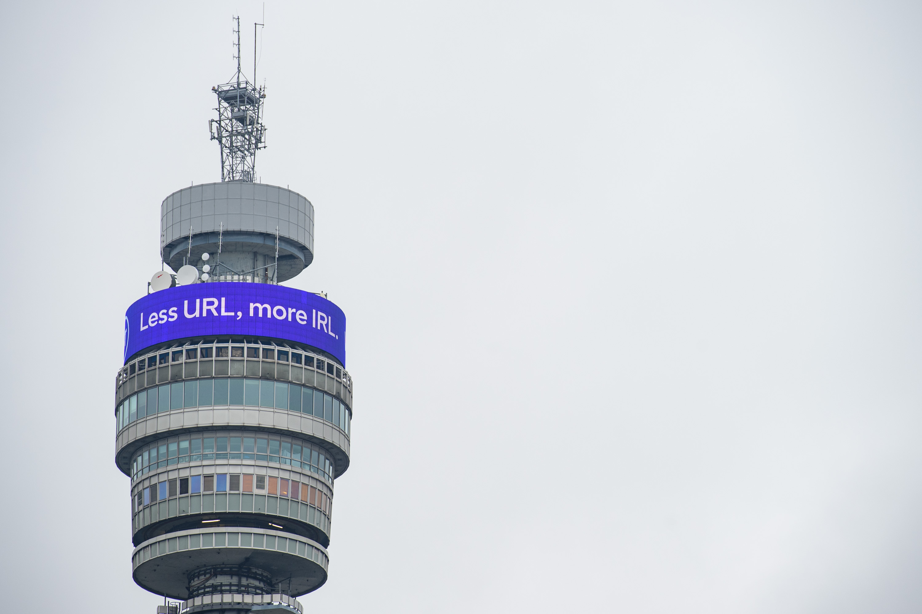 """<p>EDITORIAL USE ONLY A digital message, which reads """"Less URL, more IRL. Welcome back."""" is displayed on the BT Tower Infoband, 190 metres above the streets of London as BT marks the latest phase of the government's Covid-19 lockdown measures easing. Picture date: Monday May 17, 2021.</p>"""