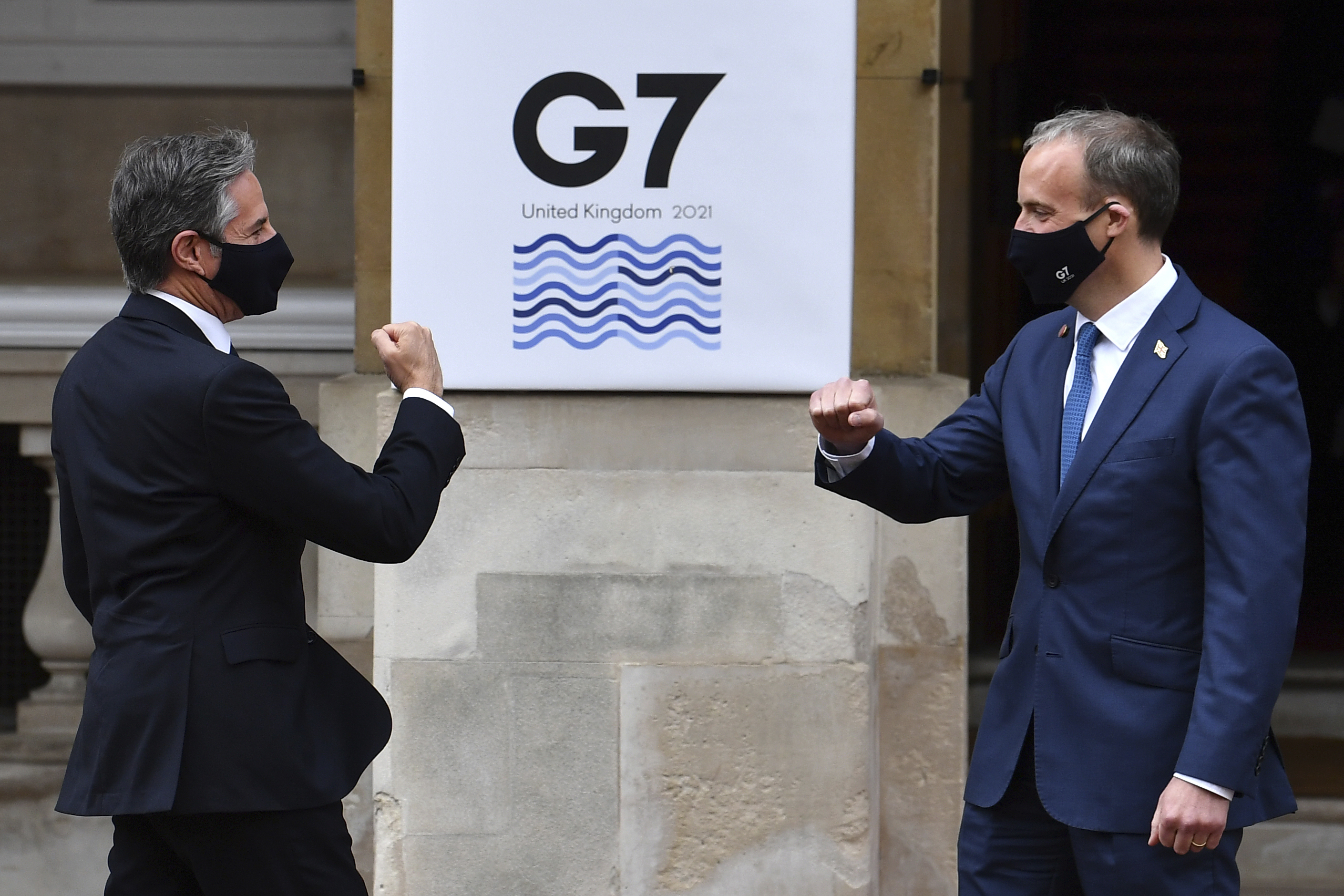 <p>US Secretary of State Antony Blinken, left, is greeted by Britain's Foreign Secretary Dominic Raab at the start of the G7 foreign ministers meeting in London Tuesday May 4, 2021.  G7 foreign ministers meet in London Tuesday for their first face-to-face talks in more than two years. (Ben Stansall / Pool via AP)</p>