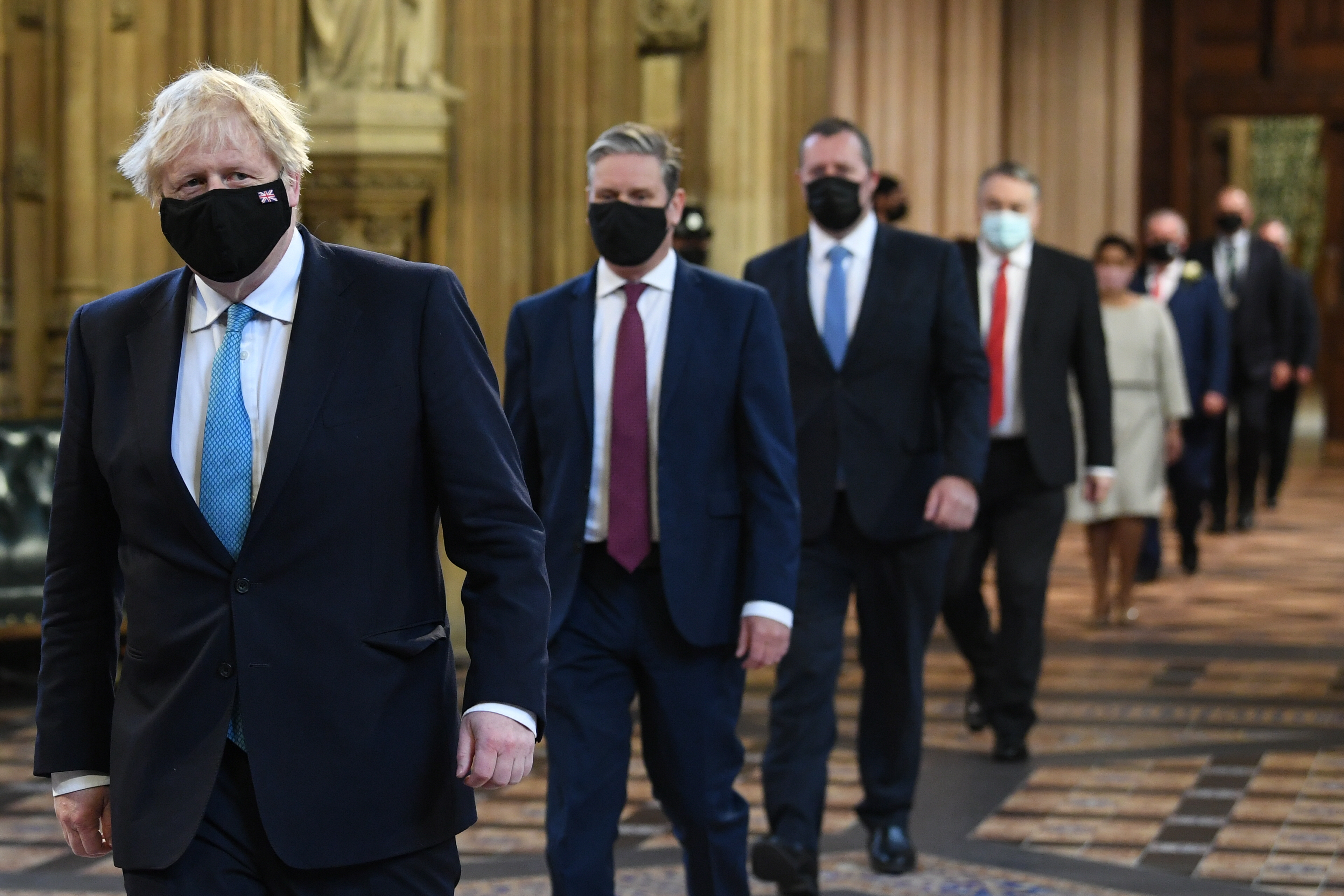 <p>Prime Minister Boris Johnson (left) and Labour leader Sir Keir Starmer (2nd left) walk through the Central Lobby on the way to the House of Lords to listen to the Queen's Speech during the State Opening of Parliament in the House of Lords at the Palace of Westminster in London. Picture date: Tuesday May 11, 2021.</p>