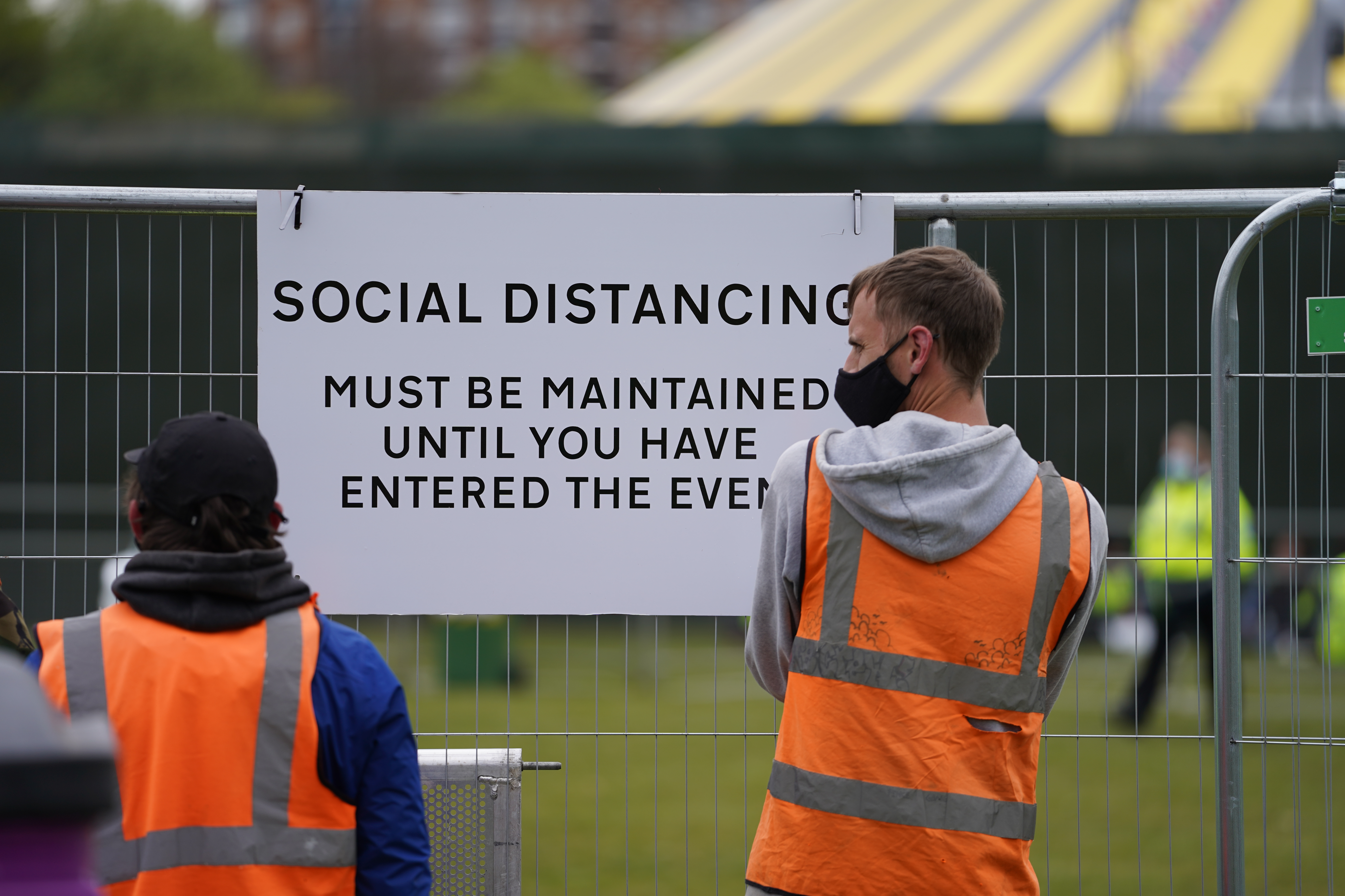 <p>Signage being put up at a music festival in Sefton Park in Liverpool as part of the national Events Research Programme (ERP). Picture date: Sunday May 2, 2021.</p>
