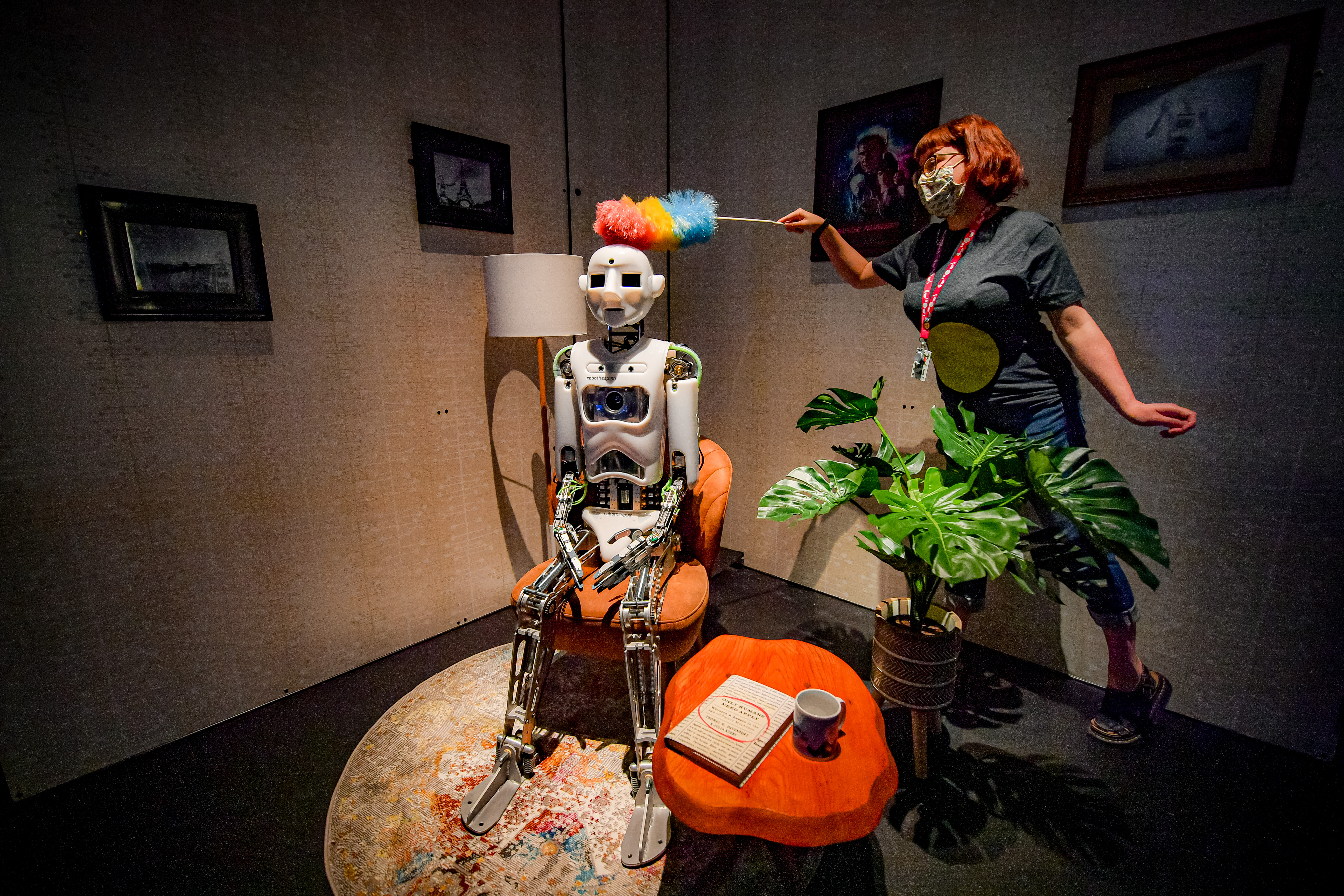 <p>Jade Hailes dusts an artificial intelligence robot called Robothespian at the science and creative venue, We The Curious, as staff and technicians clean and prepare the Bristol attraction ready for the public ahead of further easing of lockdown restrictions in England. Picture date: Monday May 10, 2021.</p>