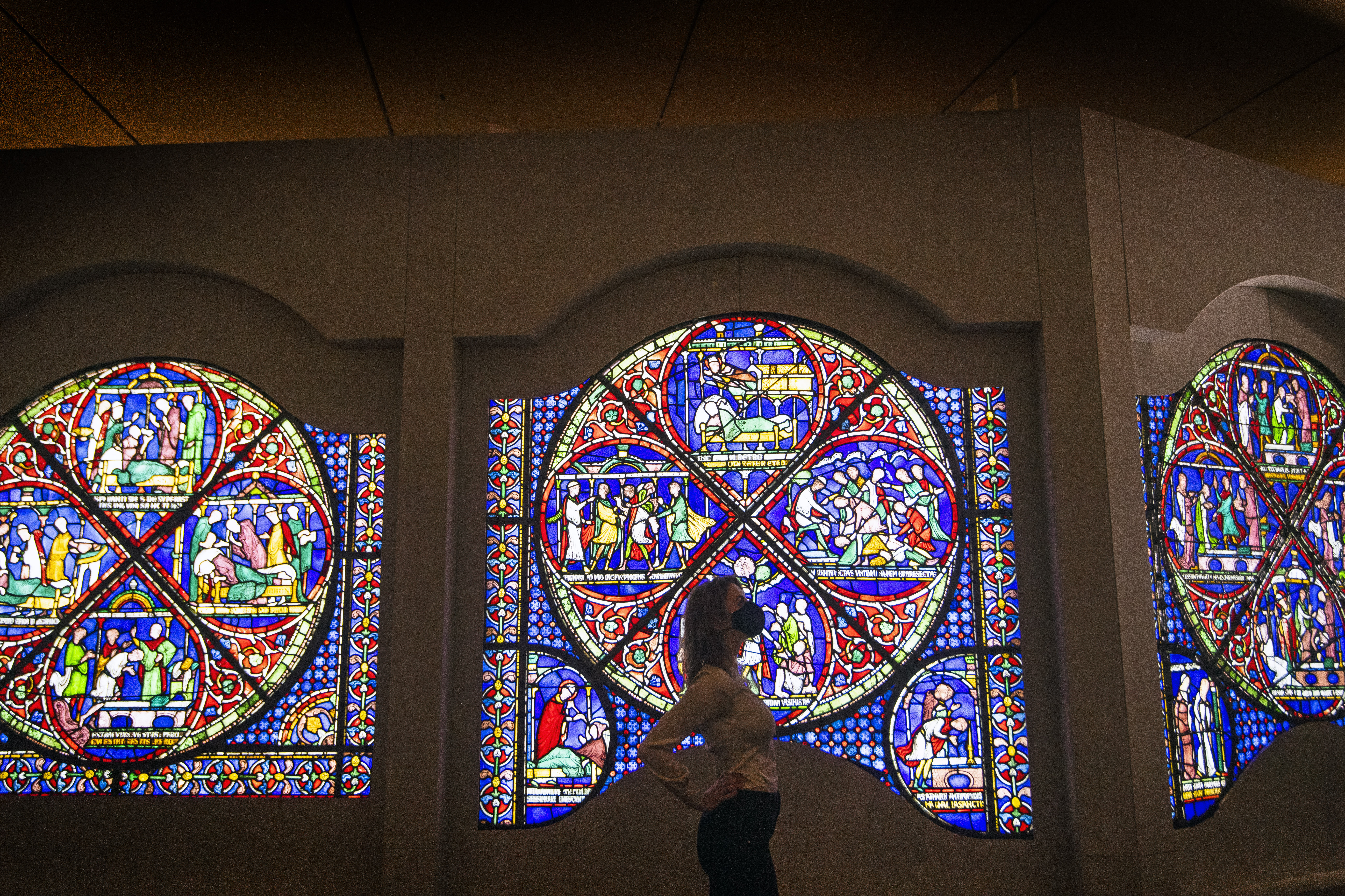 """<p>A staff member at the British Museum in London looks at an entire 800-year-old stained glass window on loan from Canterbury Cathedral to the museum for a new """"Thomas Becket: murder and the making of a saint"""" exhibition which runs May 20 to August 22, 2021, as the museum gets ready for the public ahead of further easing of lockdown restrictions in England. Picture date: Tuesday May 11, 2021.</p>"""