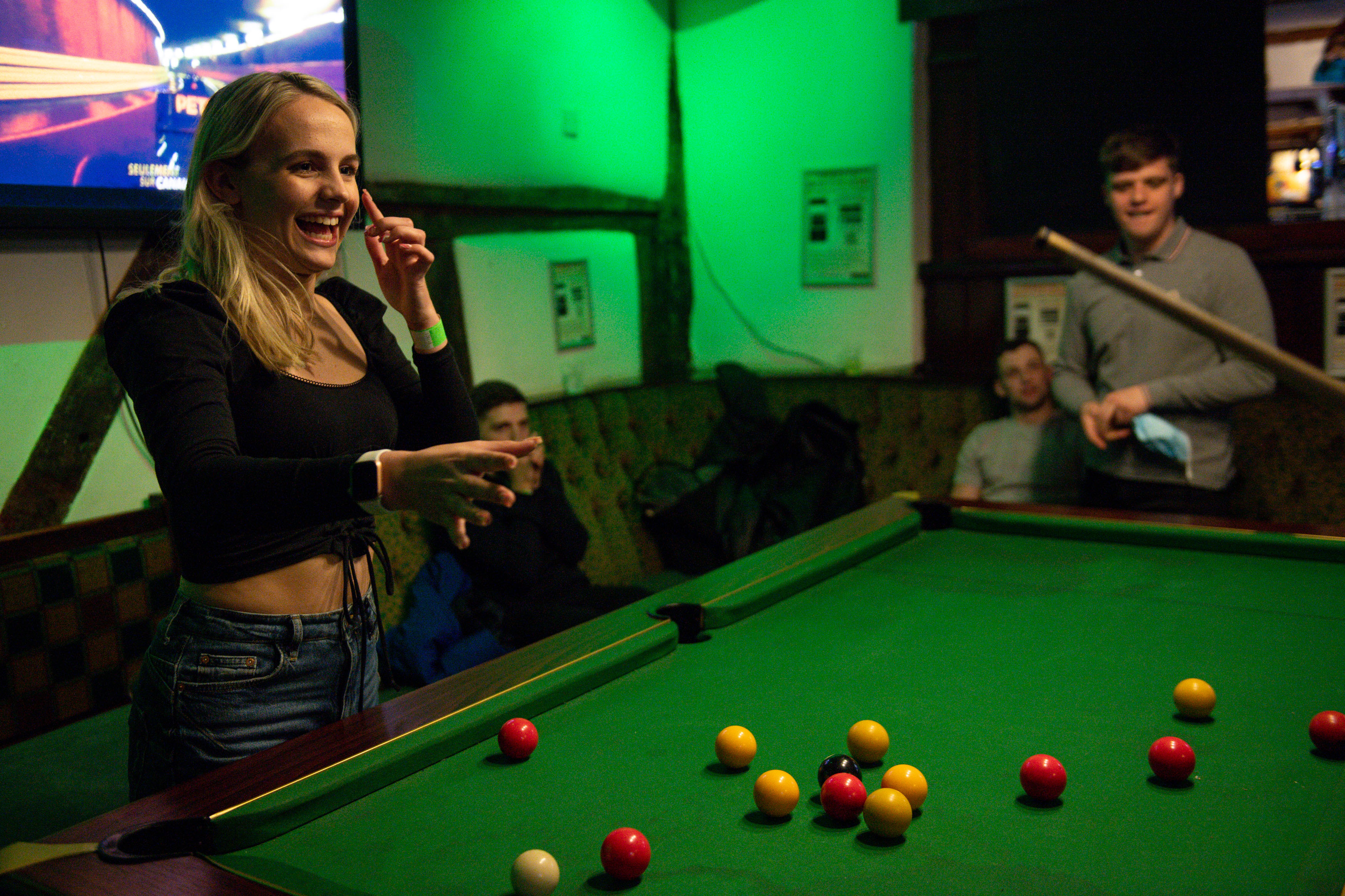 <p>Customers enjoy a game of pool at the The Oak Inn in Coventry, West Midlands, as indoor hospitality and entertainment venues reopen to the public following the further easing of lockdown restrictions in England. Picture date: Monday May 17, 2021.</p>