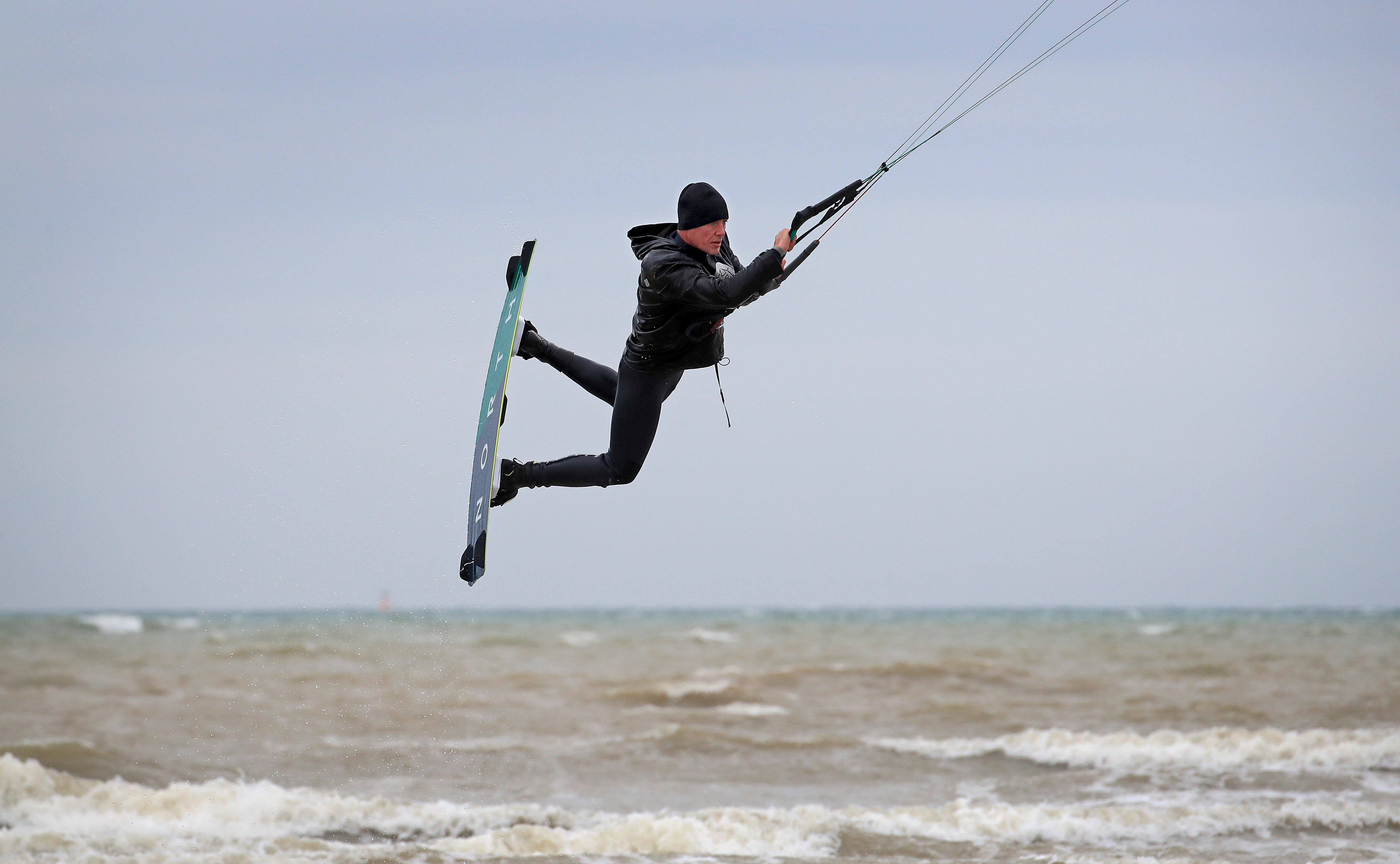 <p>A kitesurfer enjoys the strengthening winds in Camber, East Sussex. Picture date: Thursday May 20, 2021.</p>