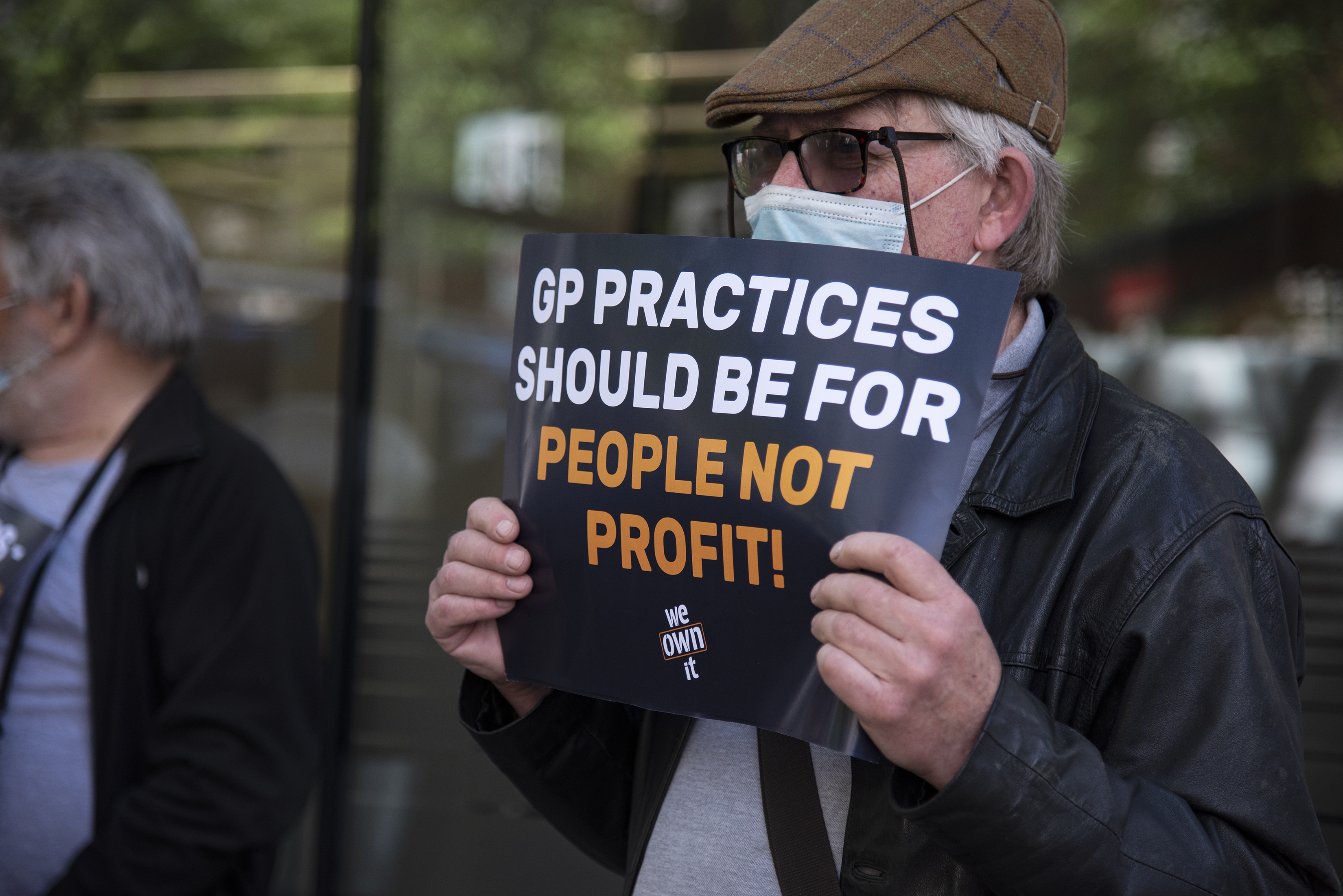 <p>A protester holding a placard expressing his opinion during the demonstration. Workers in the medical field protest against the contract renewals of further GP surgeries being taken over by the profit-greedy US healthcare giant which has become the largest single private primary care provider in England. (Photo by Loredana Sangiuliano / SOPA Images/Sipa USA)</p>