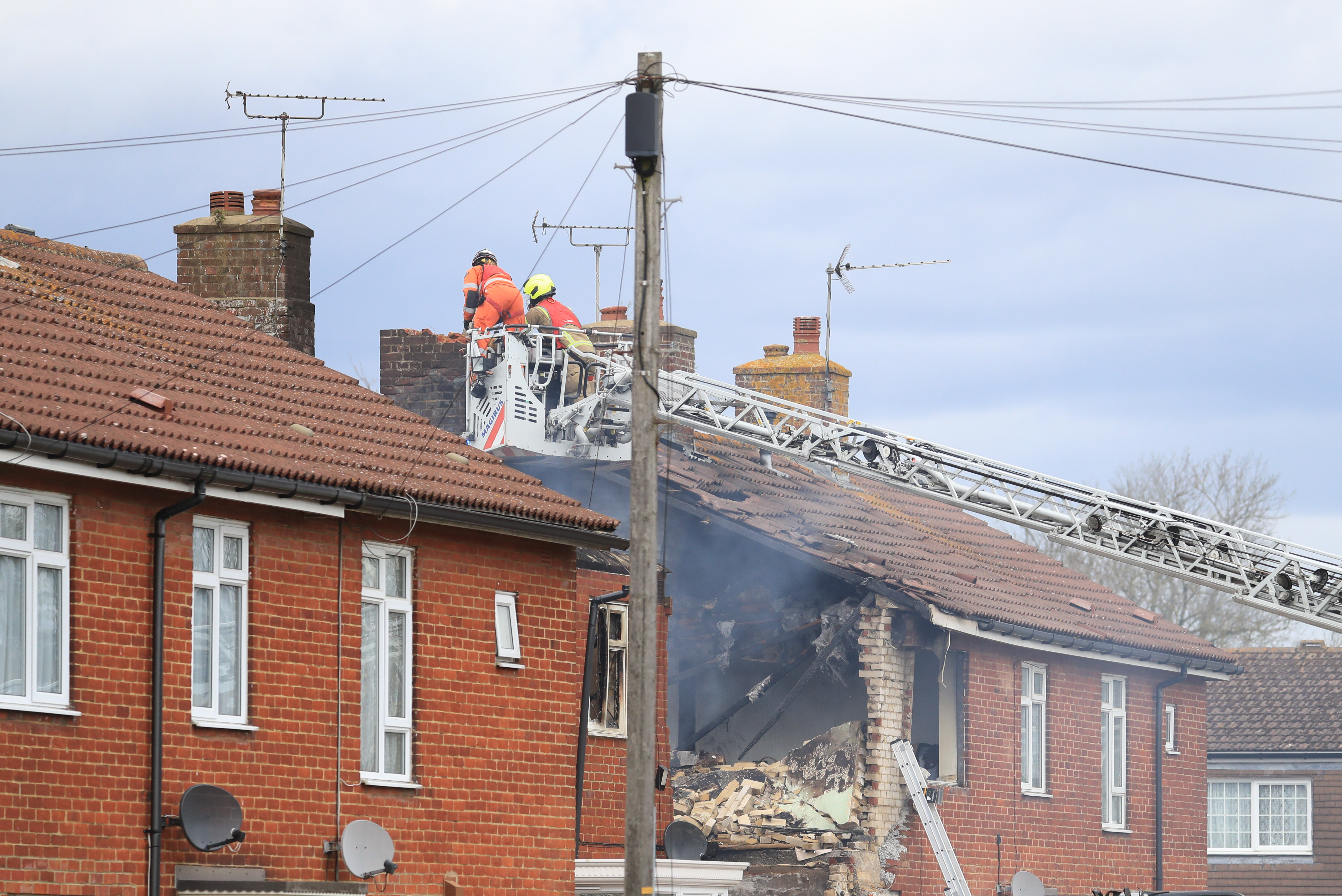 <p>Emergency services work at the scene of a house fire in Mill View in Willesborough, near Ashford, Kent following a reported explosion. Picture date: Tuesday May 4, 2021.</p>