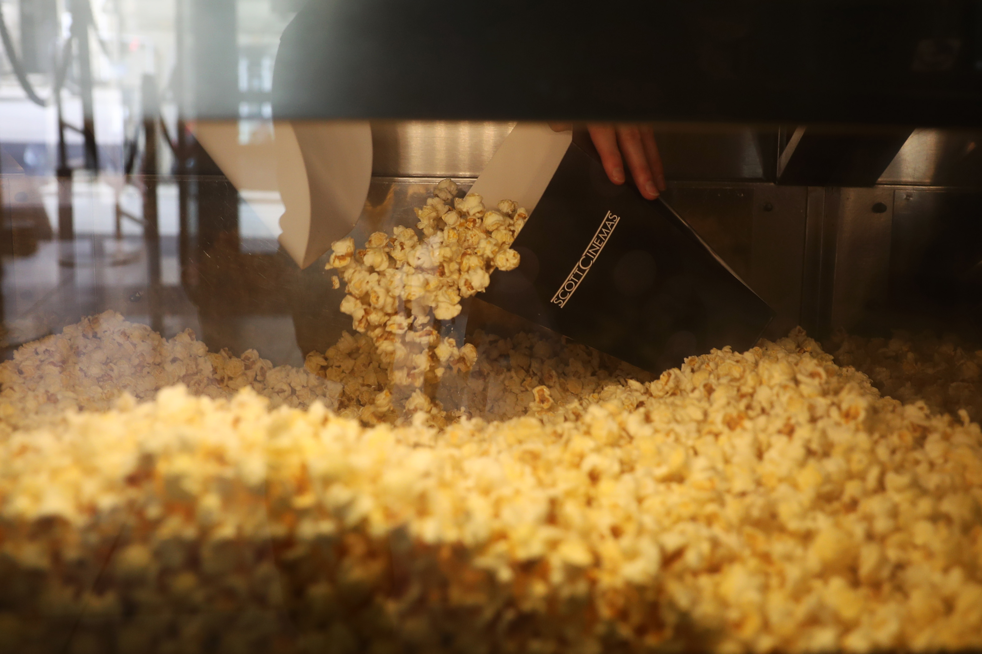 <p>TRURO, ENGLAND - MAY 17: Popcorn is served at The Plaza cinema on May 17, 2021 in Truro, England. England implements the third step in its road map out of Coronavirus lockdown today. The service industry can welcome customers inside premises to eat and drink, Fitness Classes can resume, holiday accommodation, Bingo halls, theatres, cinemas and indoor attractions will be able to welcome back customers and visitors. (Photo by Cameron Smith/Getty Images)</p>