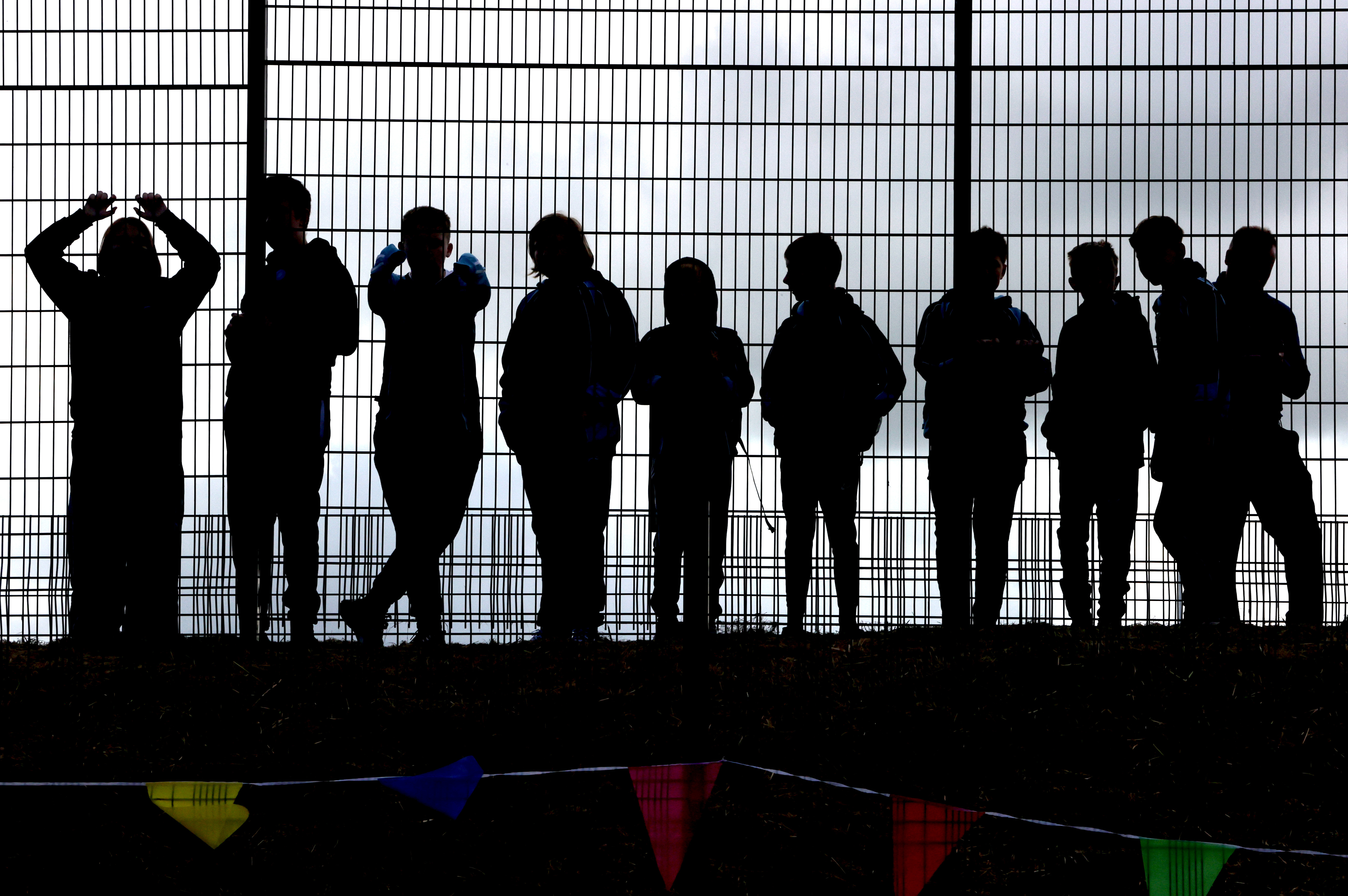 <p>School children wait for the arrival of the Prince of Wales and the Duchess of Cornwall to Bangor Market where they walked around and meeting stall holders at the open-air market. Picture date: Wednesday May 19, 2021.</p>