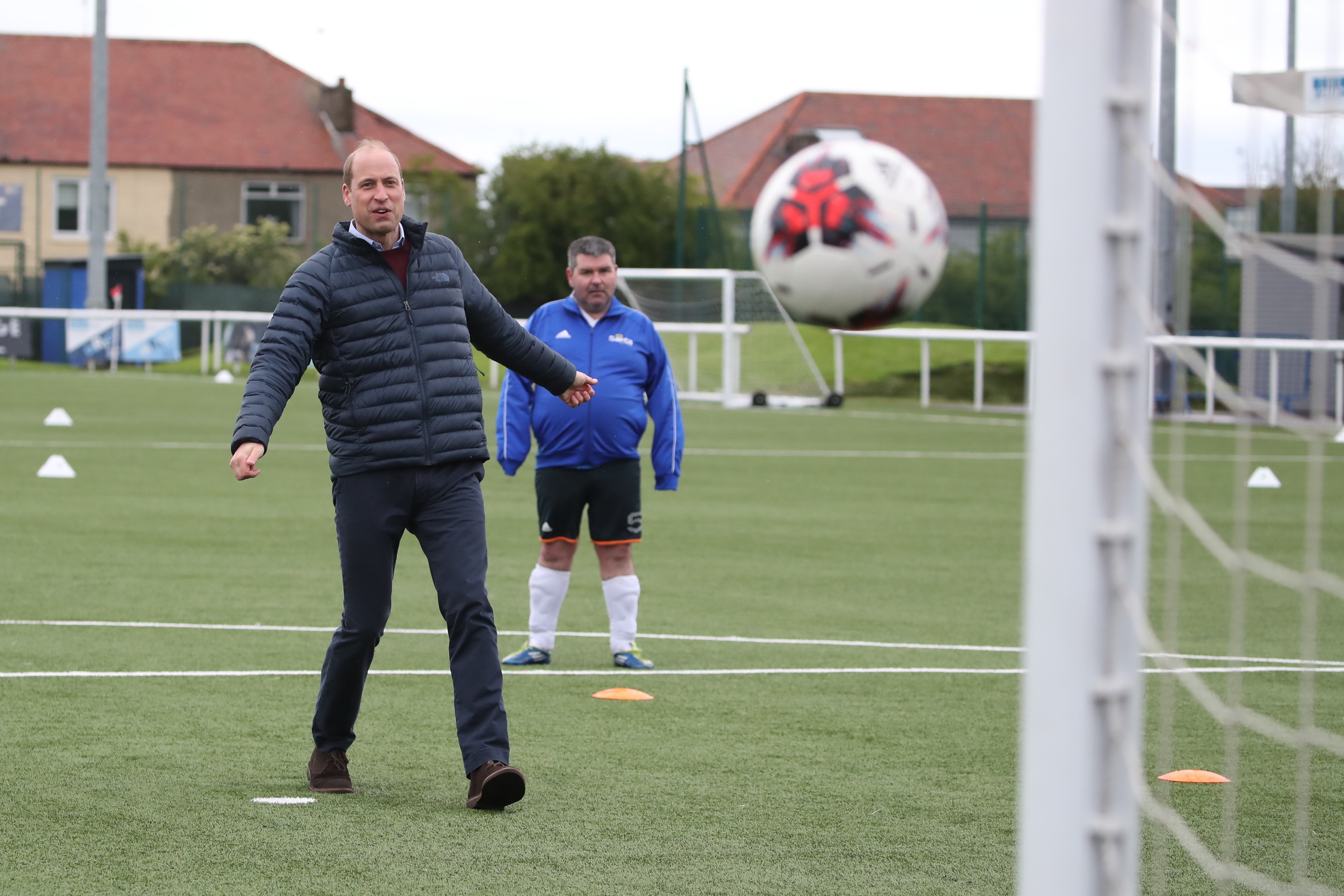 <p>The Duke of Cambridge on the pitch during a visit to Spartans FC's Ainslie Park Stadium in Edinburgh to hear about initiatives in Scottish football that champion mental health ahead of the Scottish Cup Final on Saturday. Picture date: Friday May 21, 2021.</p>