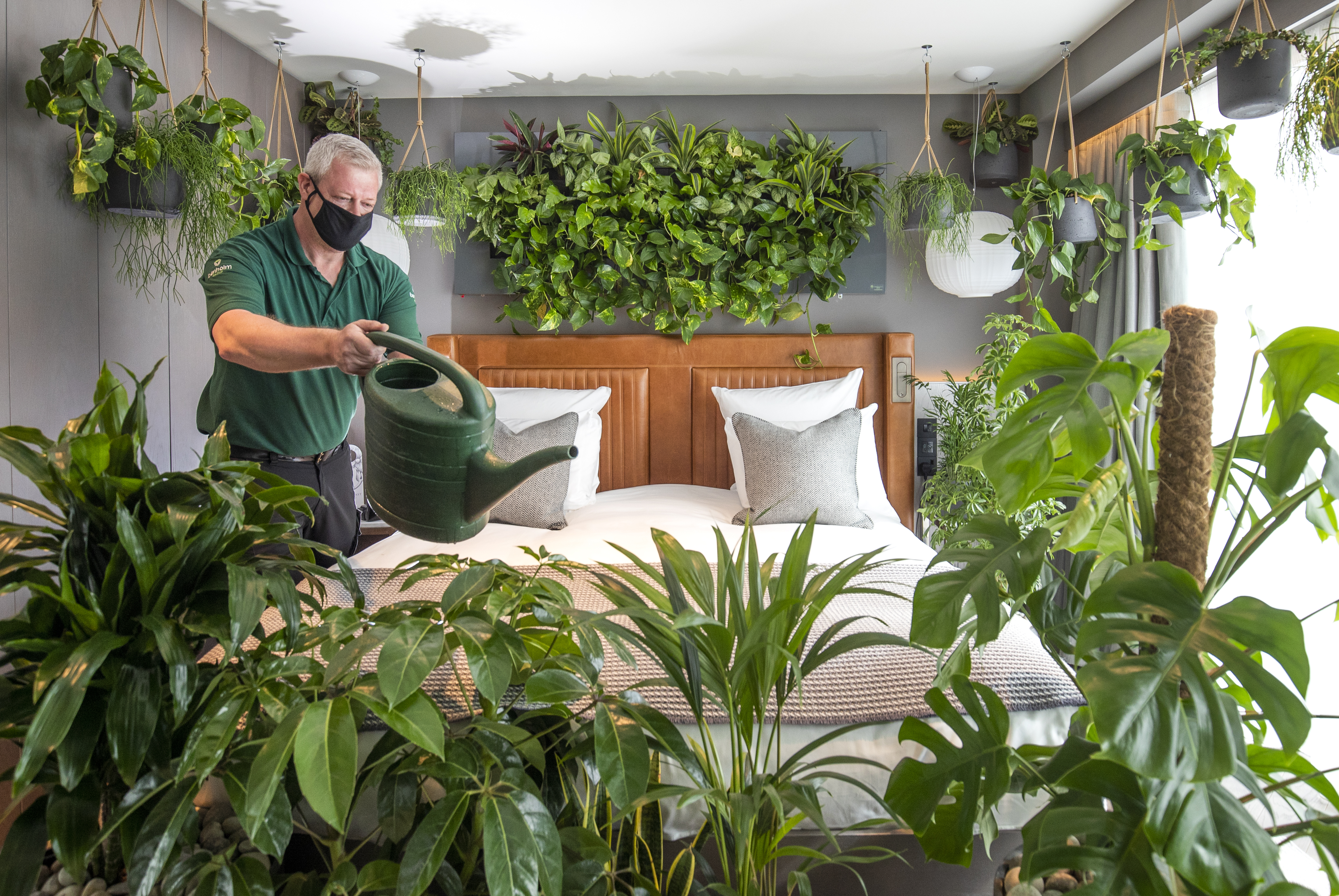 """<p>Horticulturalist Steve Soika tends to the plants in the new """"nature-themed"""" room at The Kimpton Blythswood Square hotel in Glasgow. �La Chambre Verte�, is an immersive luxury hotel suite experiment that measures the psychological and physical benefits of biophilic design and has been launched during Mental Health Awareness Week 2021. Picture date: Wednesday May 12, 2021.</p>"""