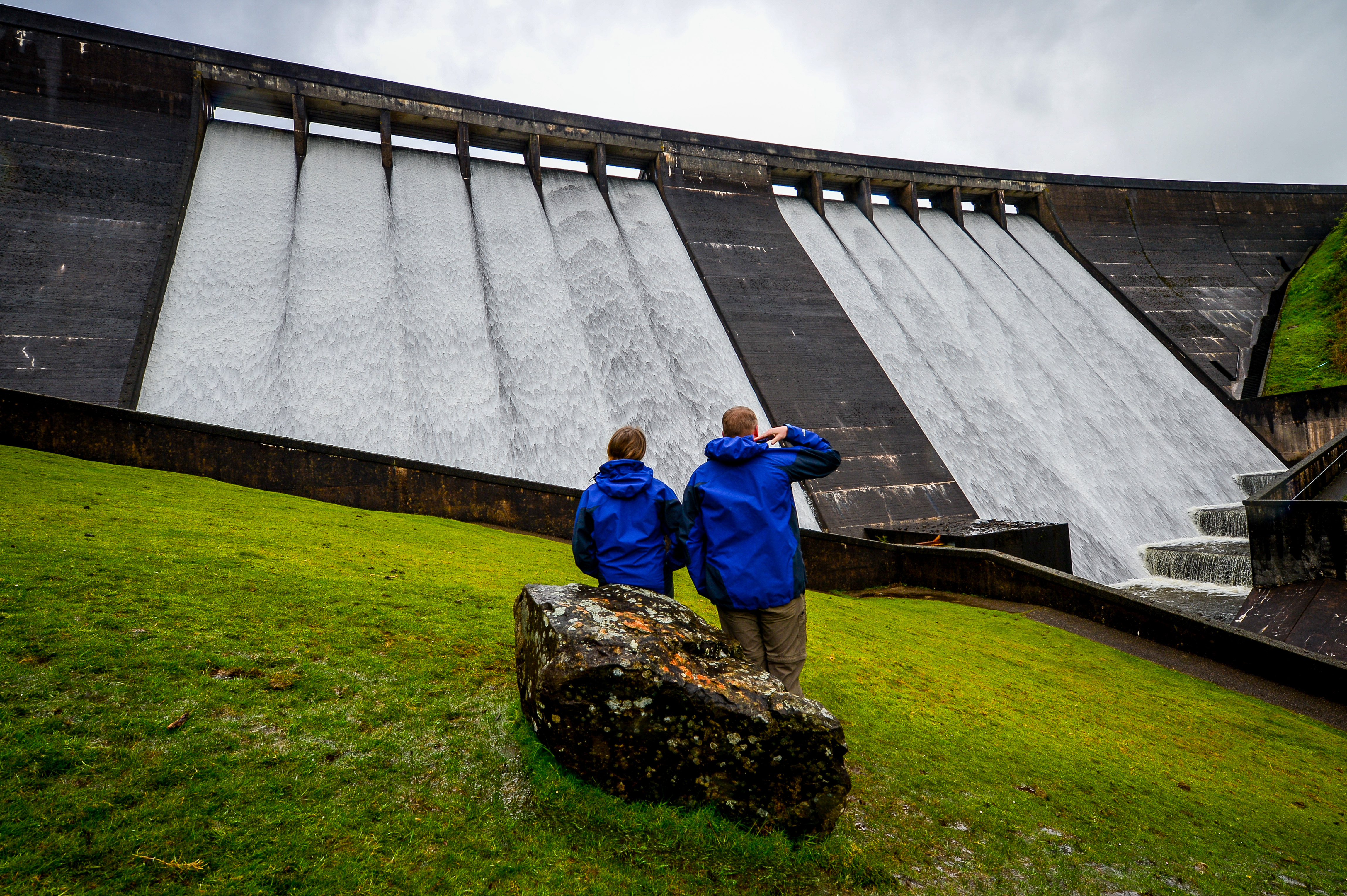 <p>People look at the overflowing spillway at Meldon Dam in Dartmoor, Devon, after heavy rain in the South West, which could see new rainfall records set for May in Devon and Wales. Picture date: Monday May 24, 2021.</p>