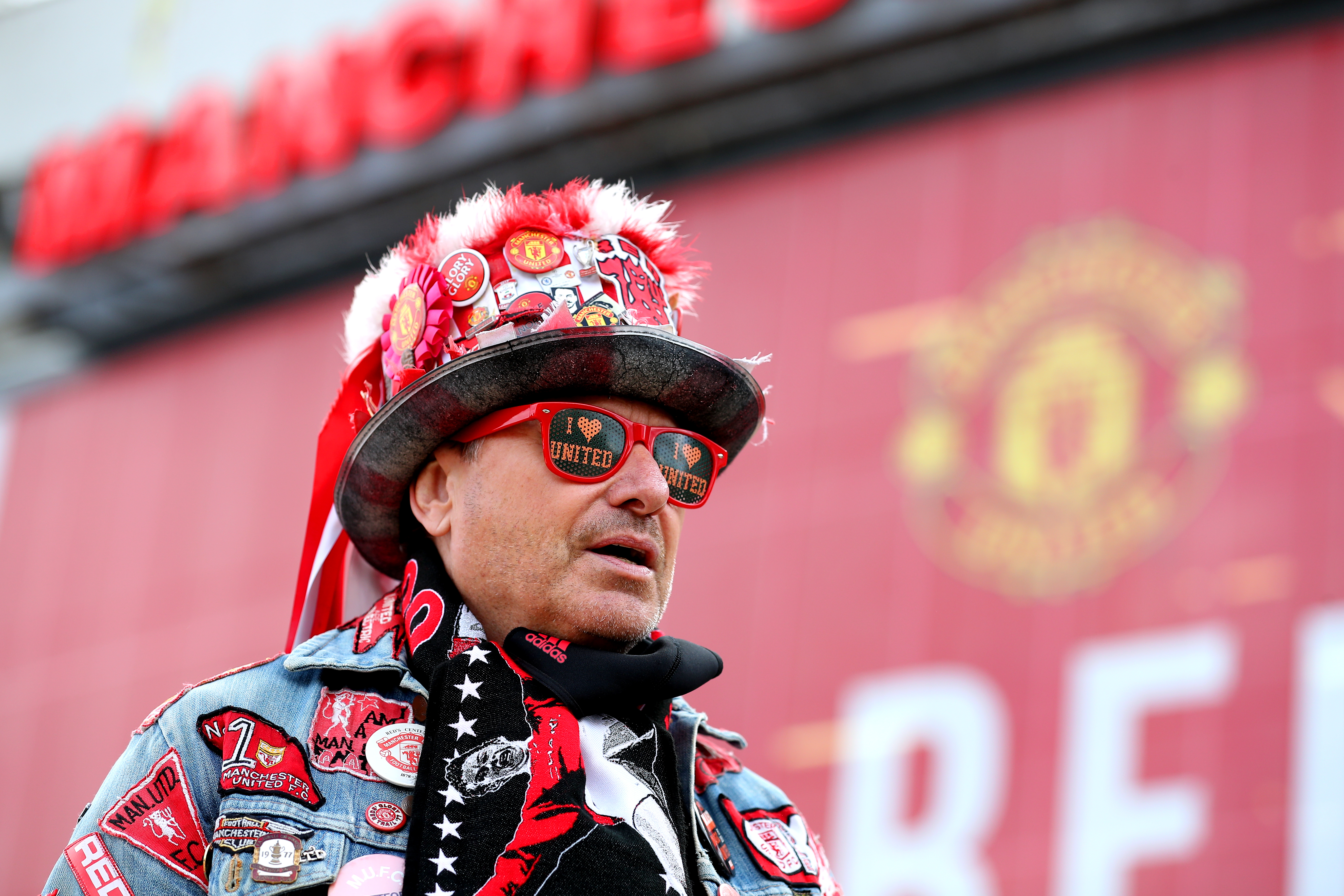 <p>A Manchester United fan arrives at the stadium before the Premier League match at Old Trafford, Manchester. Picture date: Tuesday May 18, 2021.</p>