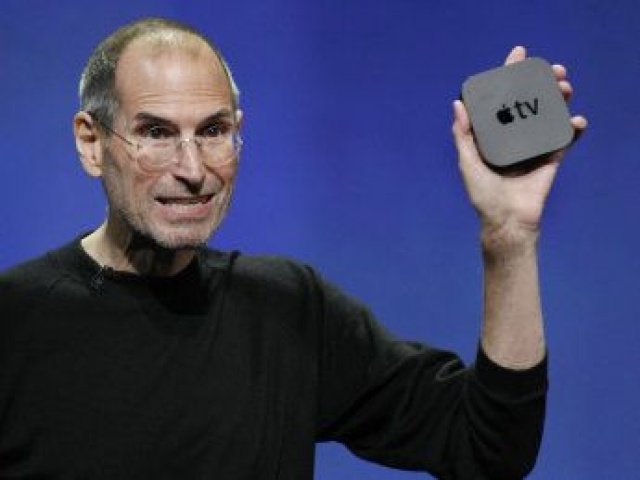 Apple CEO Steve Jobs with new AppleTV at Apple announcement in San Francisco, Wednesday, Sept. 1, 2010. (AP Photo/Paul Sakuma)