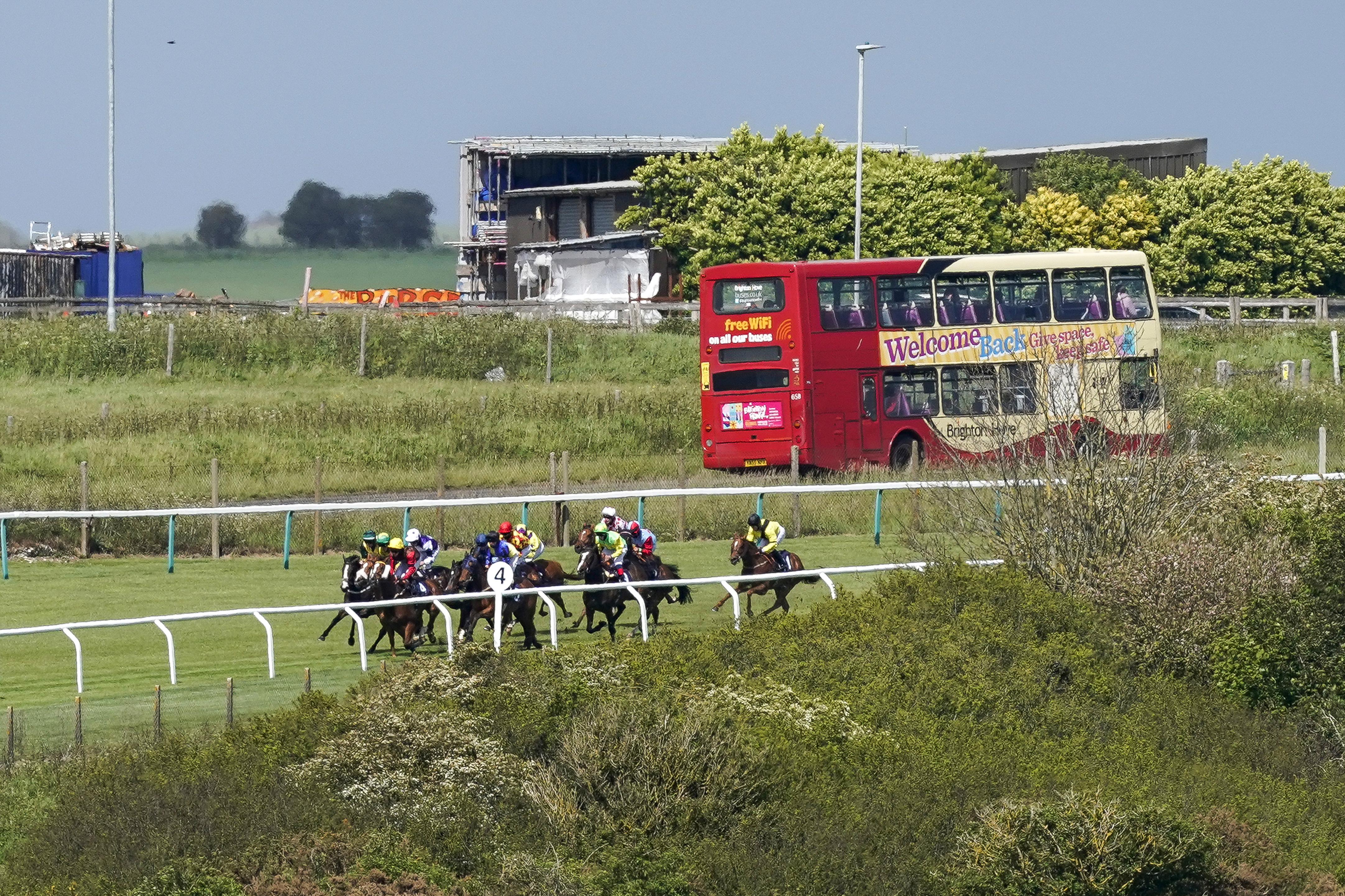 <p>A general view as runners turn into the straight in The Follow At The Races On Twitter Handicap at Brighton Racecourse. Picture date: Monday May 24, 2021.</p>