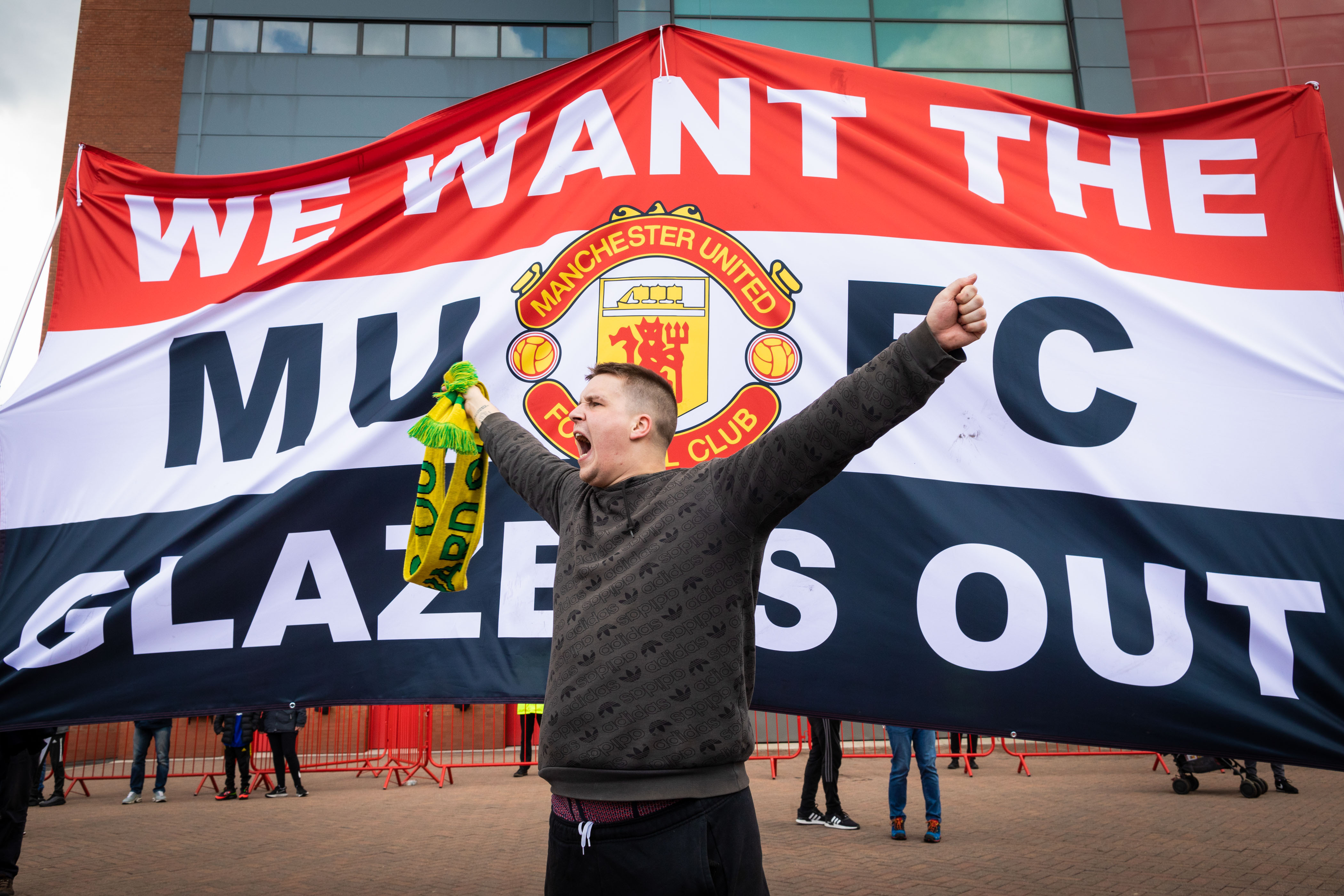 <p>A football fan chants slogans in front of a banner before a protest against the Glazer's ownership of Manchester United. (Photo by Andy Barton / SOPA Images/Sipa USA)</p>