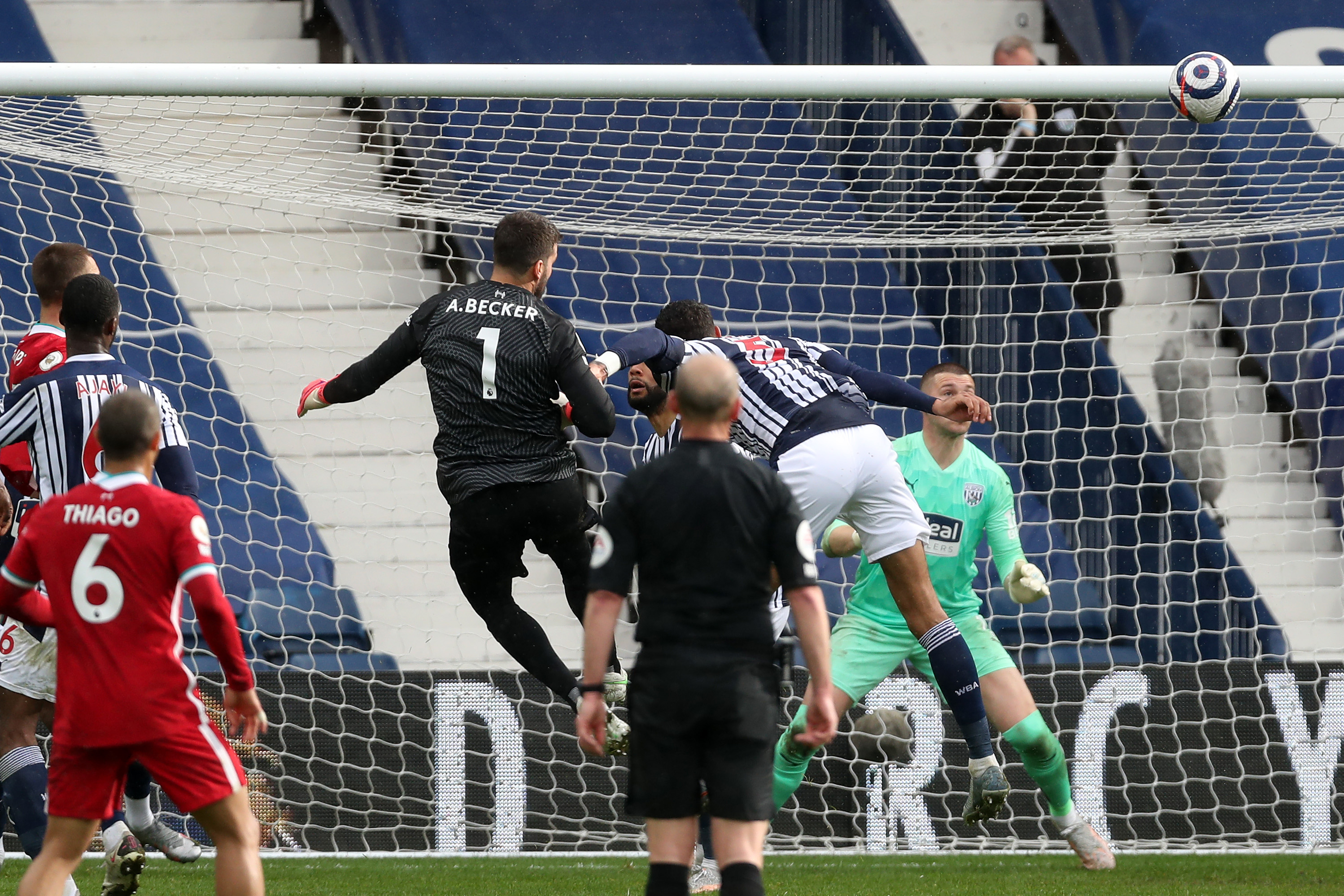 <p>WEST BROMWICH, ENGLAND - MAY 16: Goalkeeper Alisson Becker of Liverpool scores a goal to make it 1-2 during the Premier League match between West Bromwich Albion and Liverpool at The Hawthorns on May 16, 2021 in West Bromwich, United Kingdom. (Photo by Adam Fradgley - AMA/West Bromwich Albion FC via Getty Images)</p>