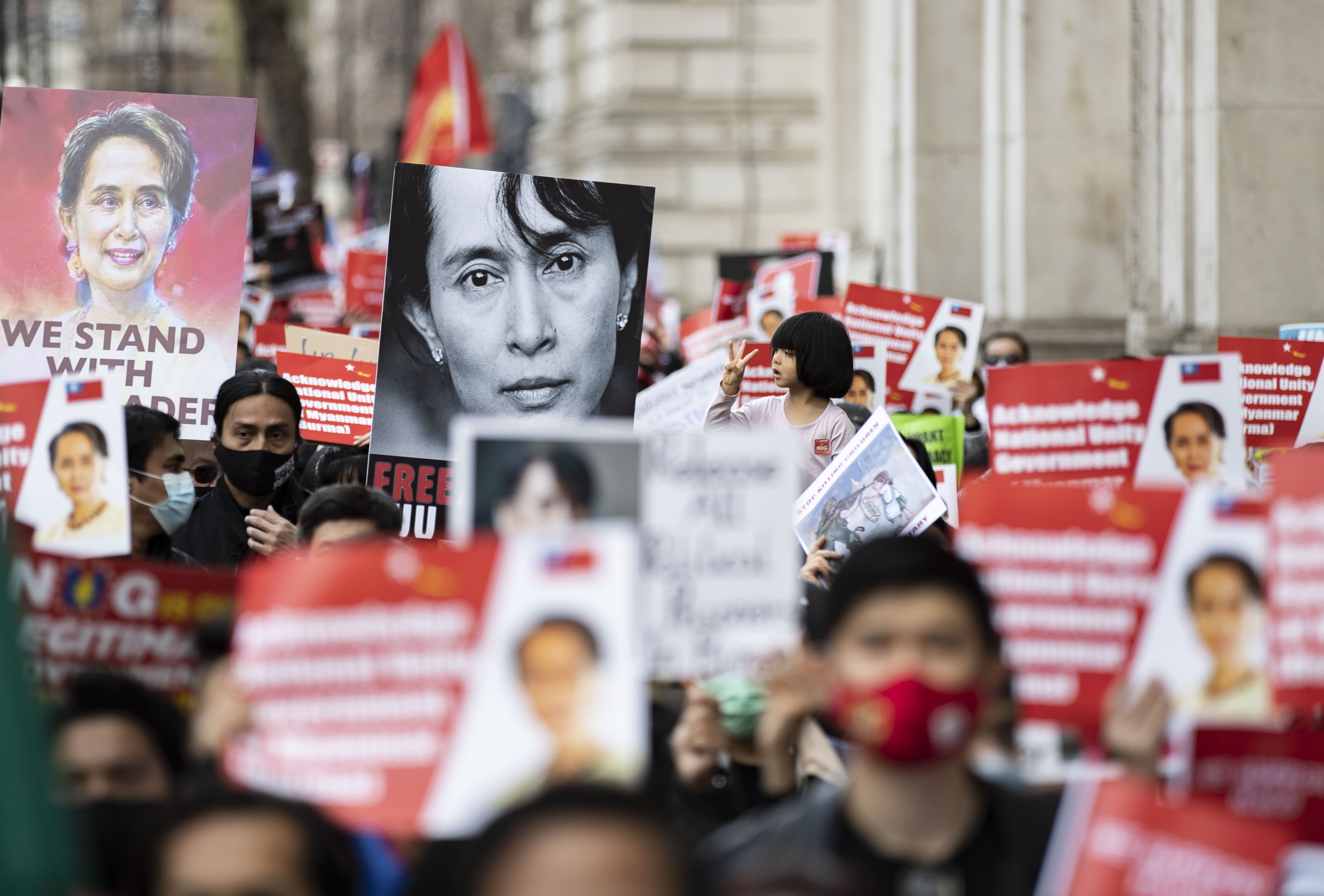 <p>Protesters hold placards during the global Myanmar Spring Revolution as they match to Trafalgar Square in London. 18 countries, 37 cities and ground activists joined hand in hand showing solidarity with democratic protesters in Myanmar during The global Myanmar Spring Revolution. Since February 1, 2021, following a general election which was won by Aung San Suu Kyi�s National League for Democracy (NLD) party, the military seized control and has declared a year-long state of emergency. Hundreds of people, including children, have been killed. Many people been detained including the elected leader Aung San Suu Kyi and members of her NLD party. (Photo by May James / SOPA Images/Sipa USA)</p>