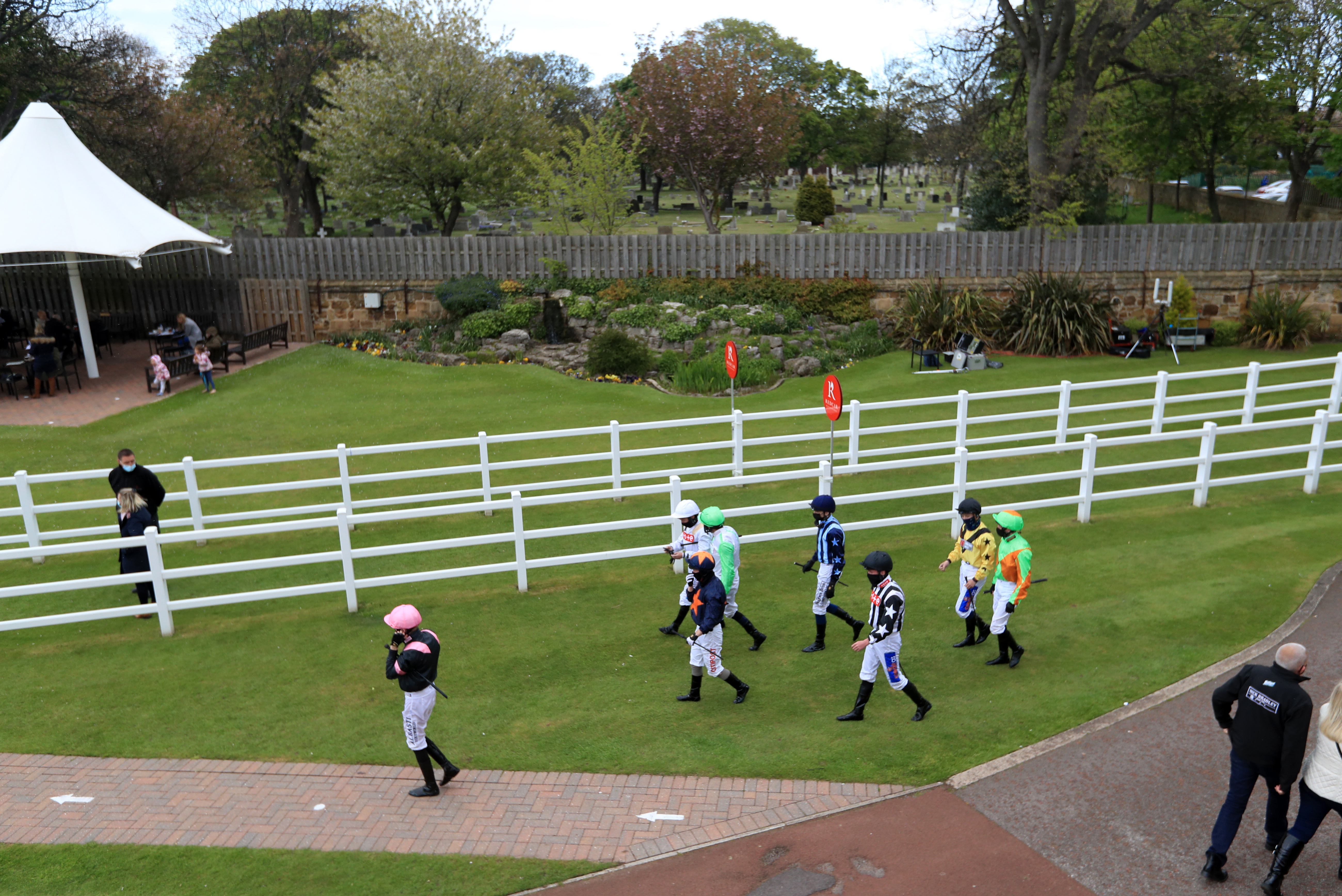 <p>REDCAR, ENGLAND - MAY 17: Jockeys make their way towards the parade ring before the Watch Racing TV In Stunning HD Handicap at Redcar Racecourse on May 17, 2021 in Redcar, England. (Photo by Mike Egerton-Pool/Getty Images)</p>
