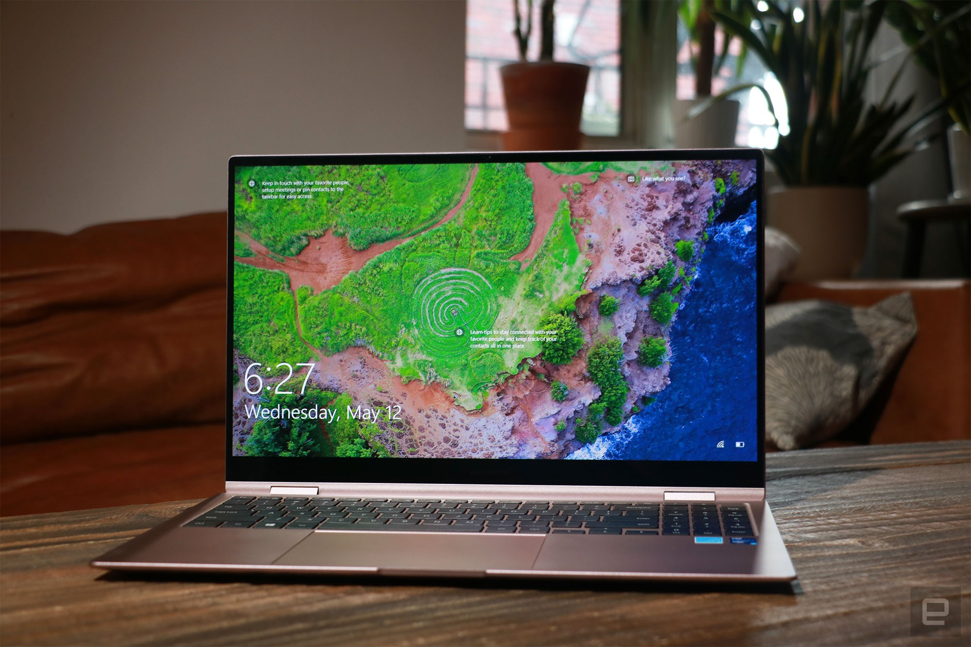 <p>Samsung Galaxy Book Pro 360 review pictures. Front view of the 15-inch Galaxy Book Pro 360 on a table in front of a brown couch.</p>