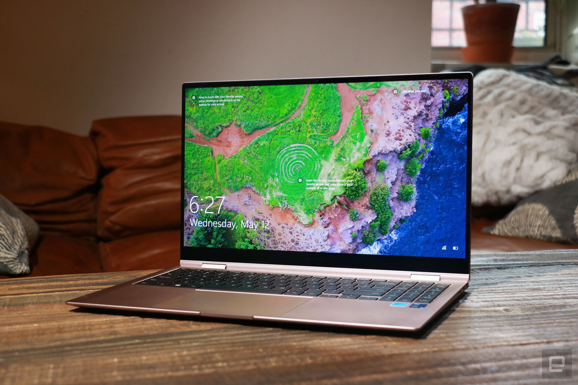 <p>Samsung Galaxy Book Pro 360 review pictures. Off-angle front view of the 15-inch Galaxy Book Pro 360 on a table in front of a brown couch.</p>