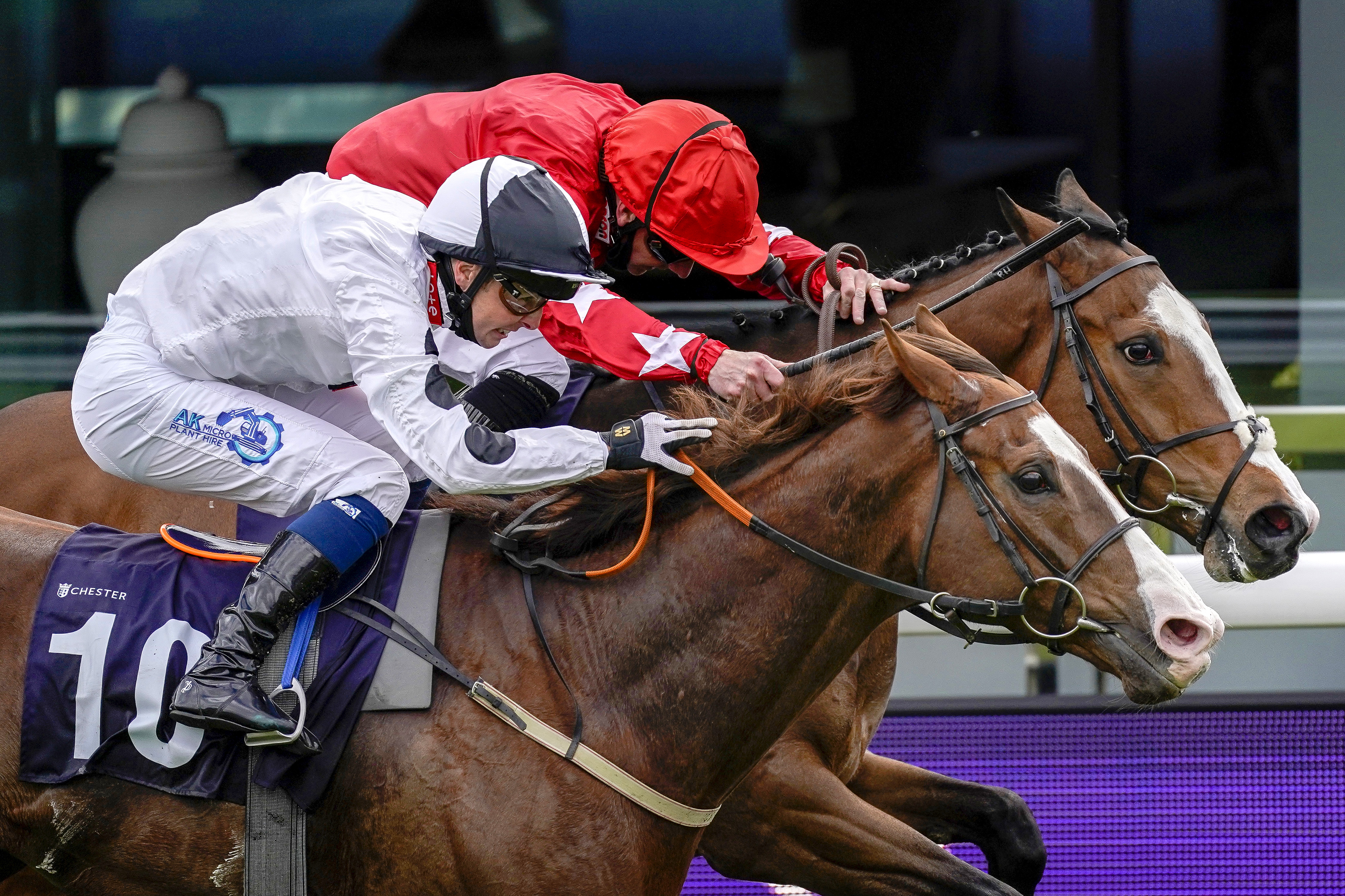 <p>Baryshnikov ridden by Connor Beasley (left, white silks) beats Spirit Dancer ridden by Paul Hanagan to win the Destination 2 Handicap during Ladies Day of the Boodles May Festival 2021 at Chester Racecourse. Picture date: Thursday May 6, 2021. See PA story RACING Chester. Photo credit should read: Alan Crowhurst/PA Wire. RESTRICTIONS: Use subject to restrictions. Editorial use only, no commercial use without prior consent from rights holder.</p>