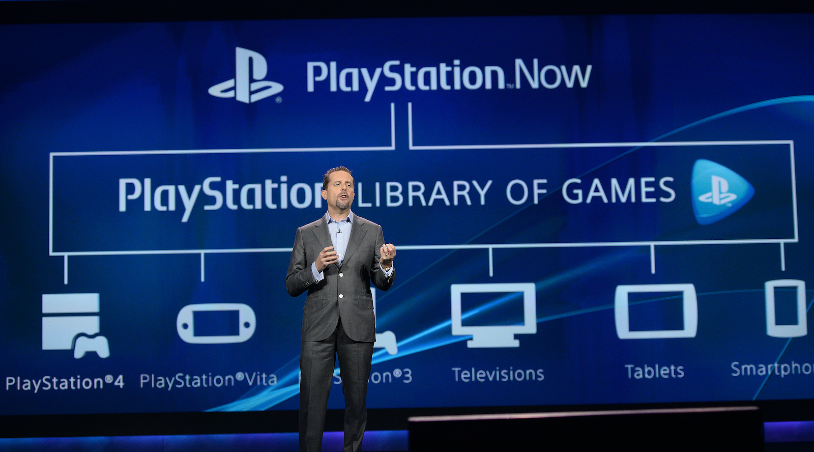Andrew House, president and group CEO, Sony Computer Entertainment, announces PlayStation Now streaming game service during the keynote address by Sony CEO and President Kazuo Hirai on the opening day of the 2014 International CES on January 7, 2014 in Las Vegas, Nevada.   AFP PHOTO / ROBYN BECK        (Photo credit should read ROBYN BECK/AFP via Getty Images)