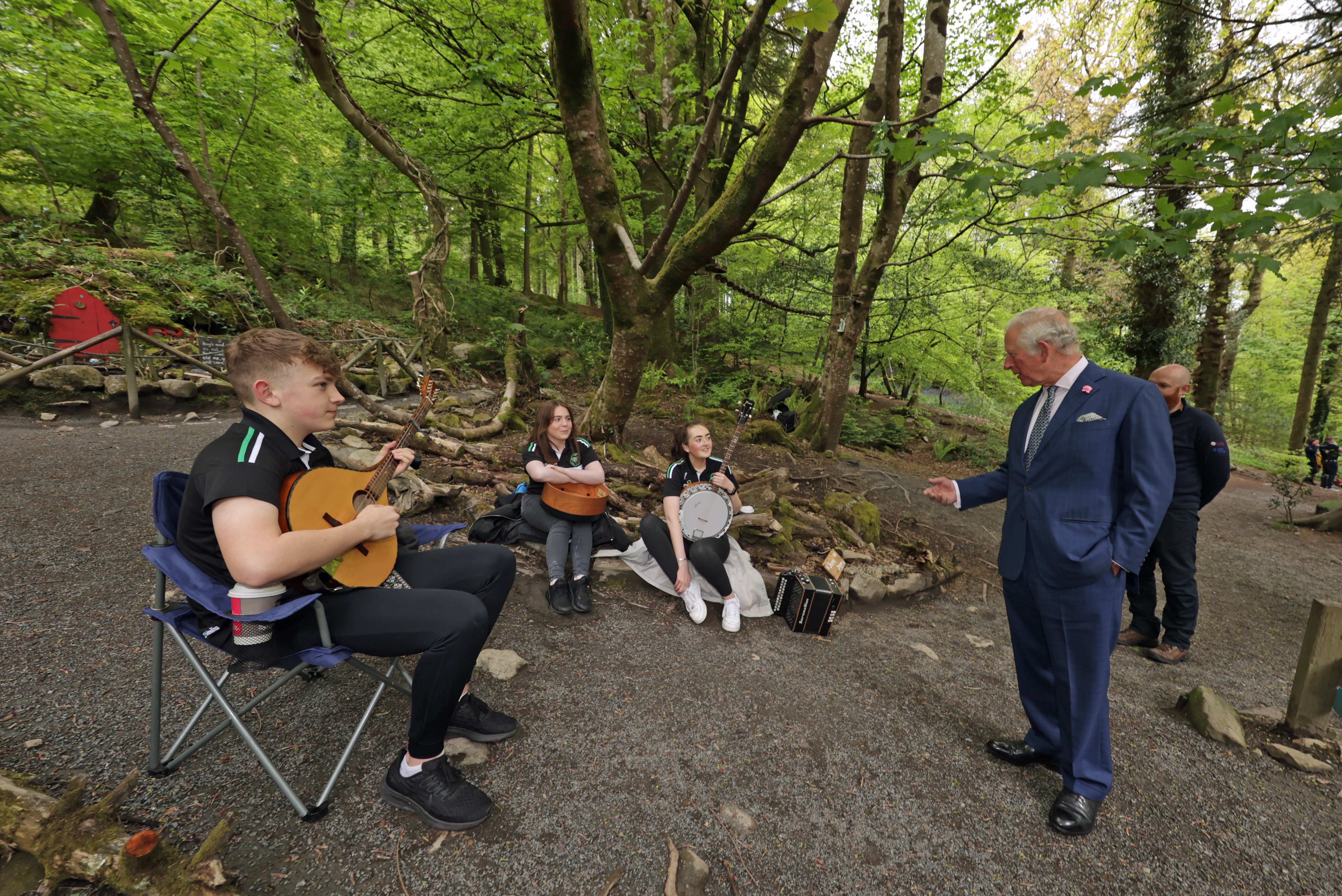 <p>The Prince of Wales talks with (left to right) Brendan O'Sullivan playing bouzouki, Ciara Grant playing bodhran, and Claire Gasey playing banjo, from the the Ring of Gullion Traditional Arts Partnership, during a visit to Slieve Gullion Forest Park in Meigh, Newry. Picture date: Tuesday May 18, 2021.</p>