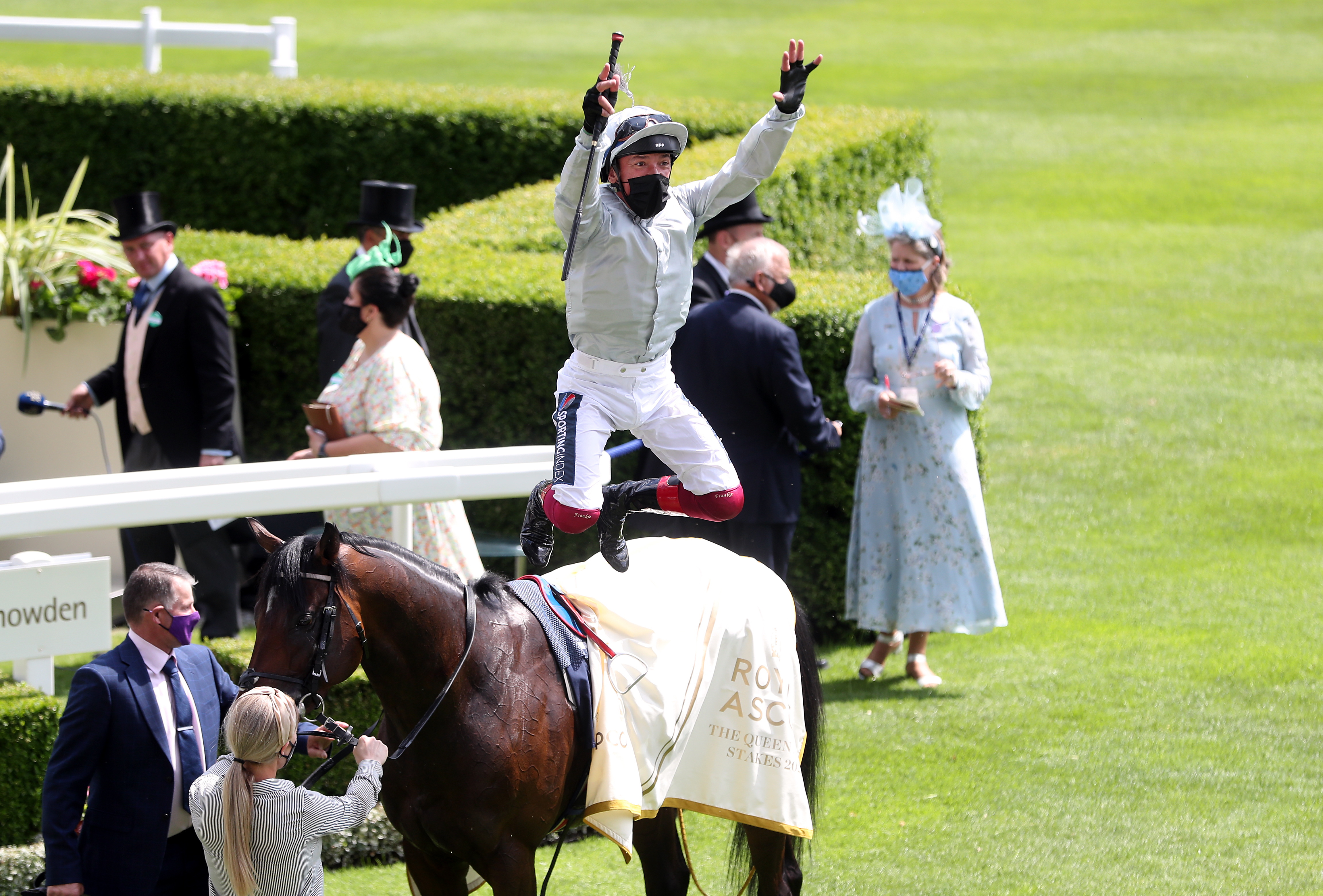 <p>Jockey Frankie Dettori performs his trademark flying dismount as he celebrates winning the Queen Anne Stakes on Palace Pier during day one of Royal Ascot at Ascot Racecourse. Picture date: Tuesday June 15, 2021.</p>