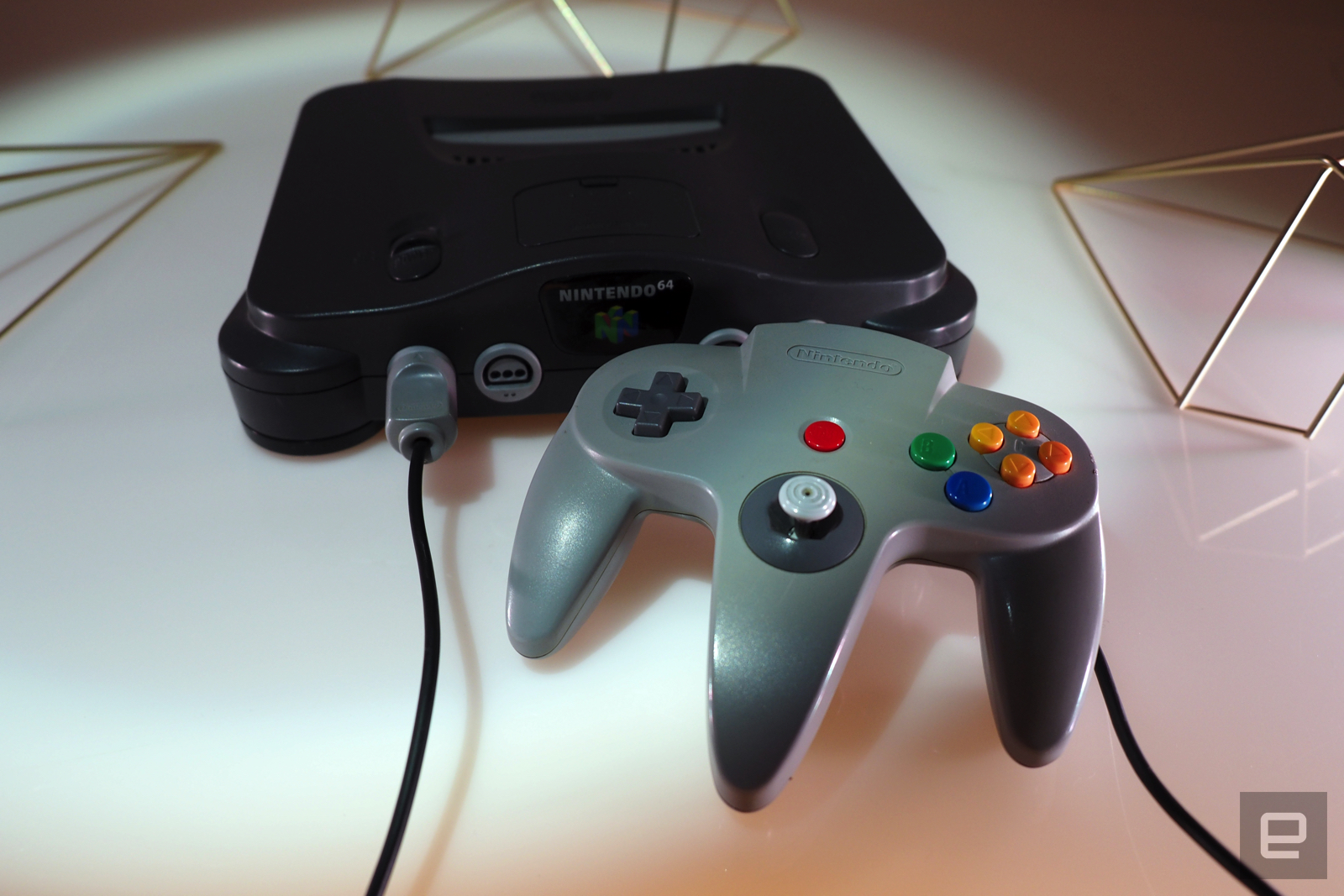 <p>Nintendo 64 on a white table with games</p>