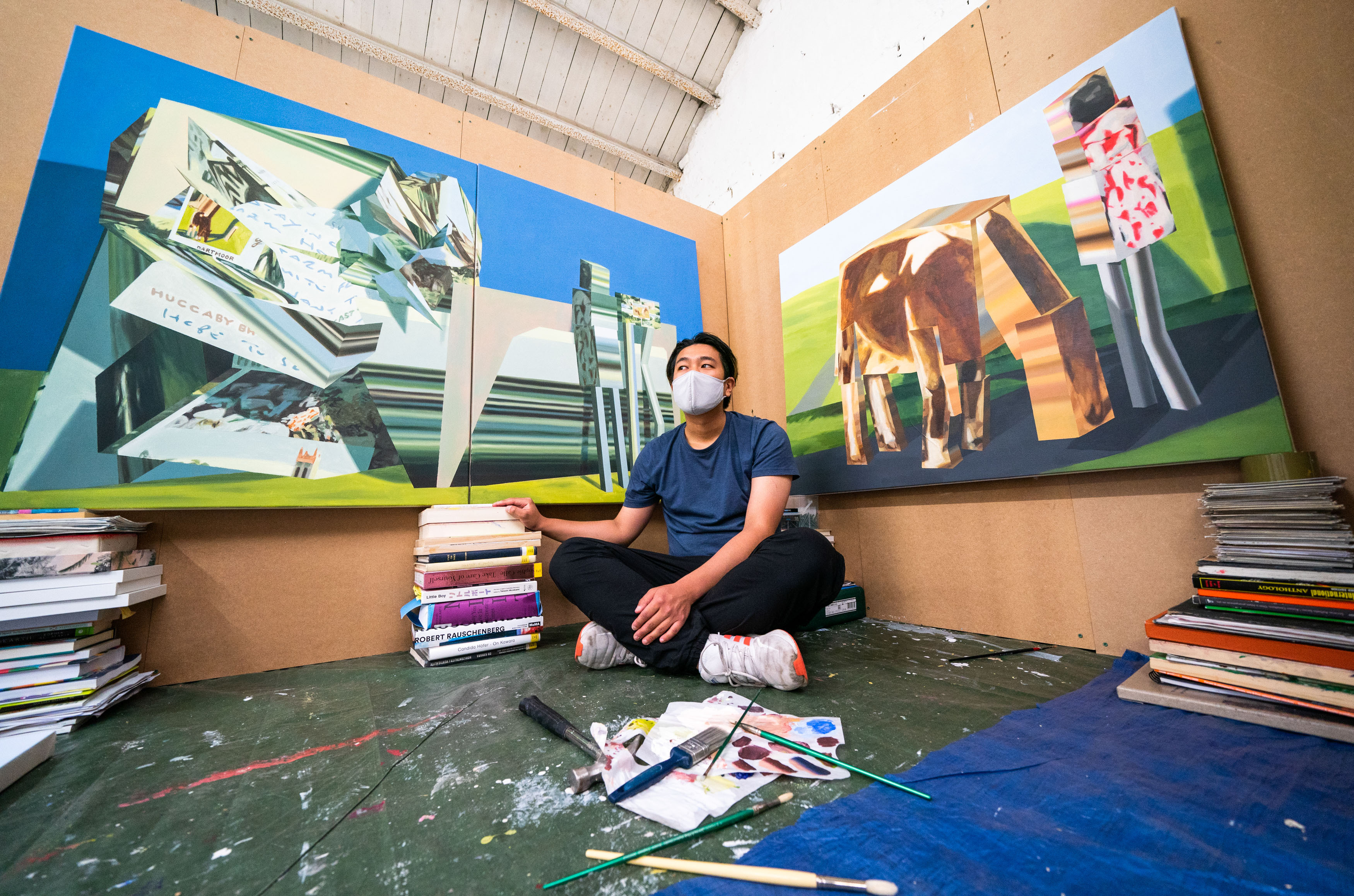 <p>Student Masaki Ishikawa alongside his paintings in his �Home Studio� installation which is on display at The Glue Factory in Glasgow, which forms part of the Glasgow School of Art exhibition �Hot Wheels� featuring works by this year�s MFA (Master of Fine Arts) graduates. Picture date: Thursday June 24, 2021.</p>