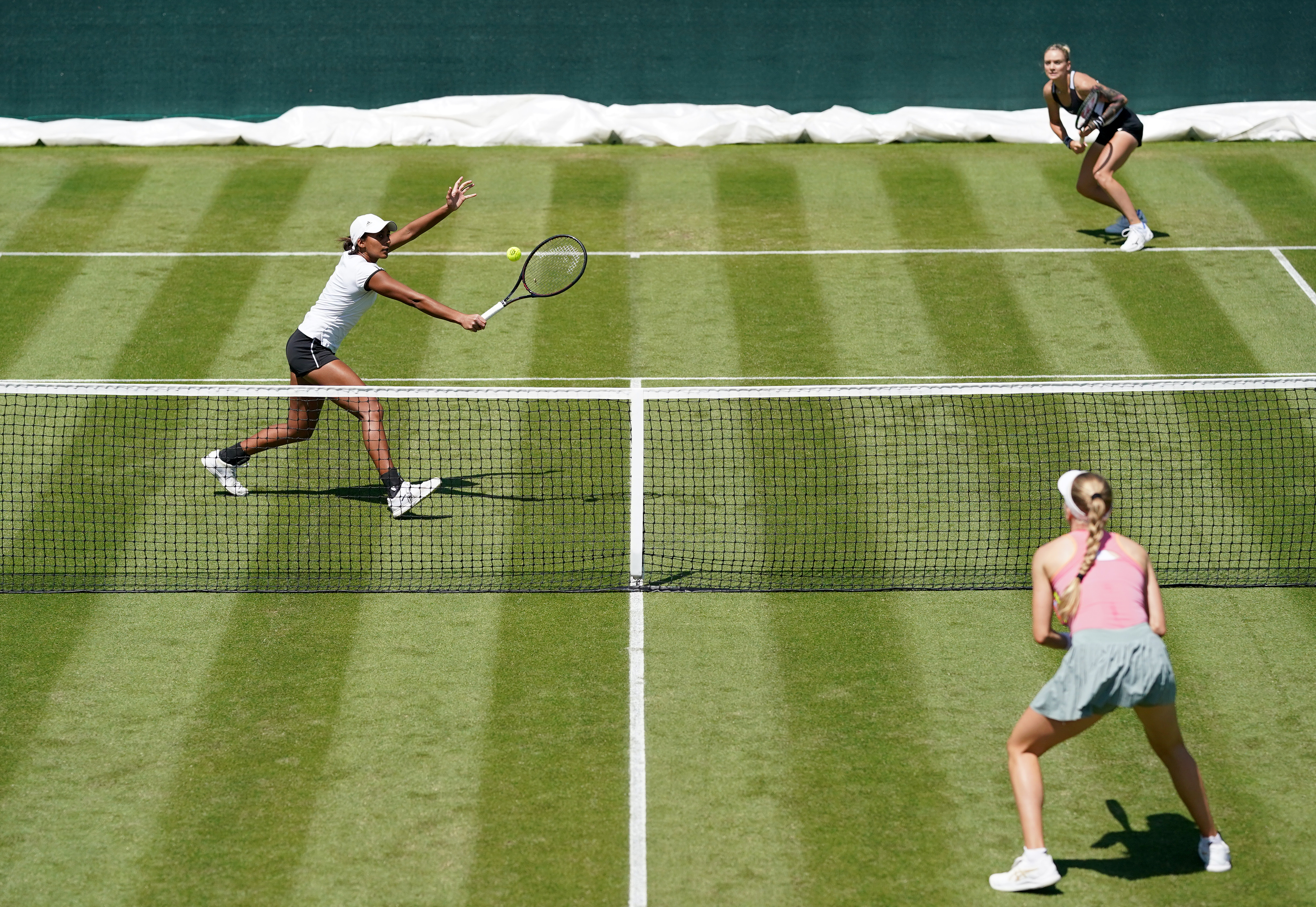 <p>Naiktha Bains (left) and Tereza Martincova in their doubles match against Heather Watson and Harriet Dart during day two of the Viking Classic at the Edgbaston Priory Club, Birmingham. Picture date: Tuesday June 15, 2021.</p>