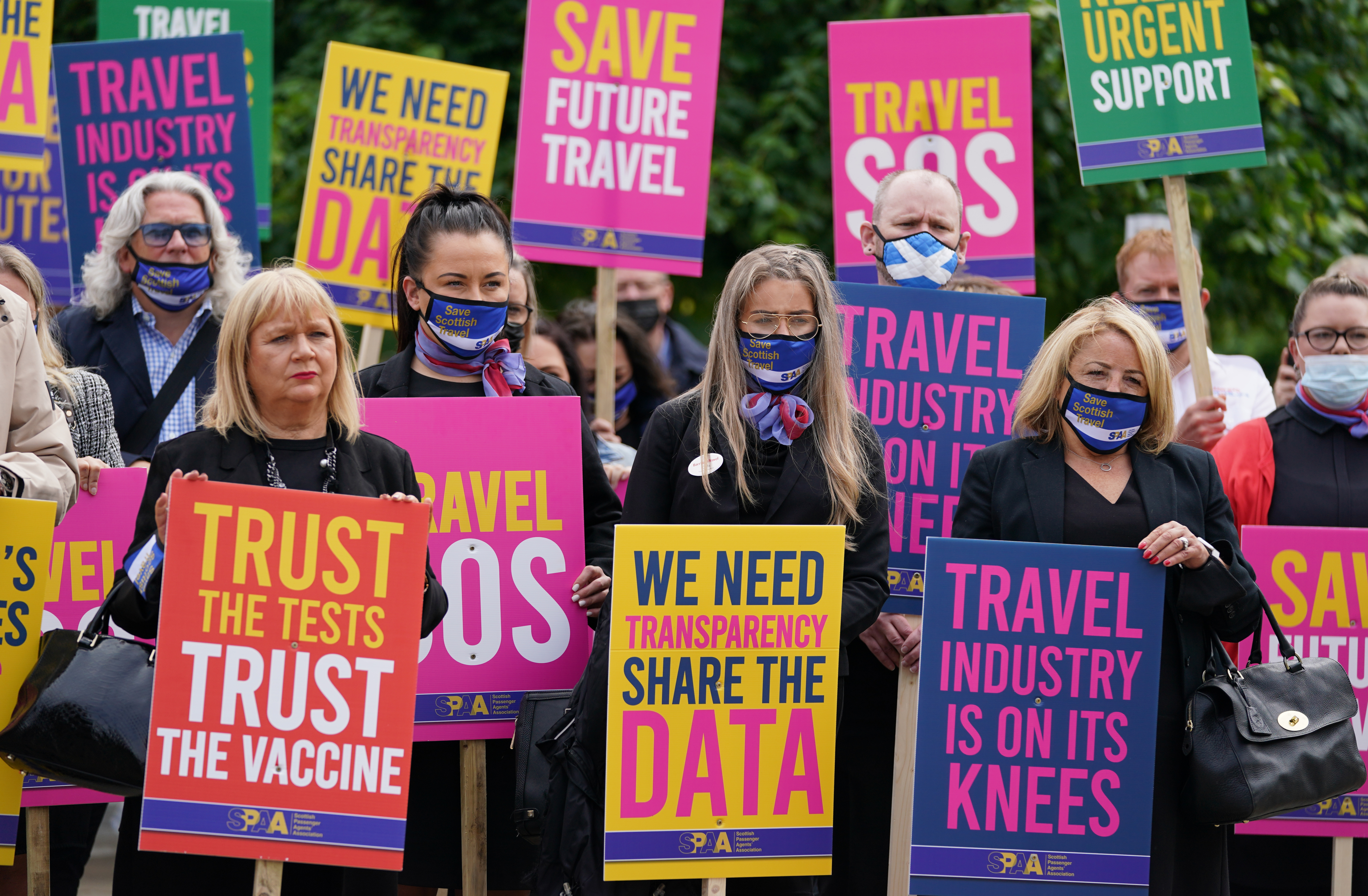<p>Trade bodies from across the aviation and travel industries outside the Scottish Parliament in Edinburgh, during a Travel Day of Action calling on the UK Government to support a safe return to international travel in time for the peak summer period. Picture date: Wednesday June 23, 2021.</p>
