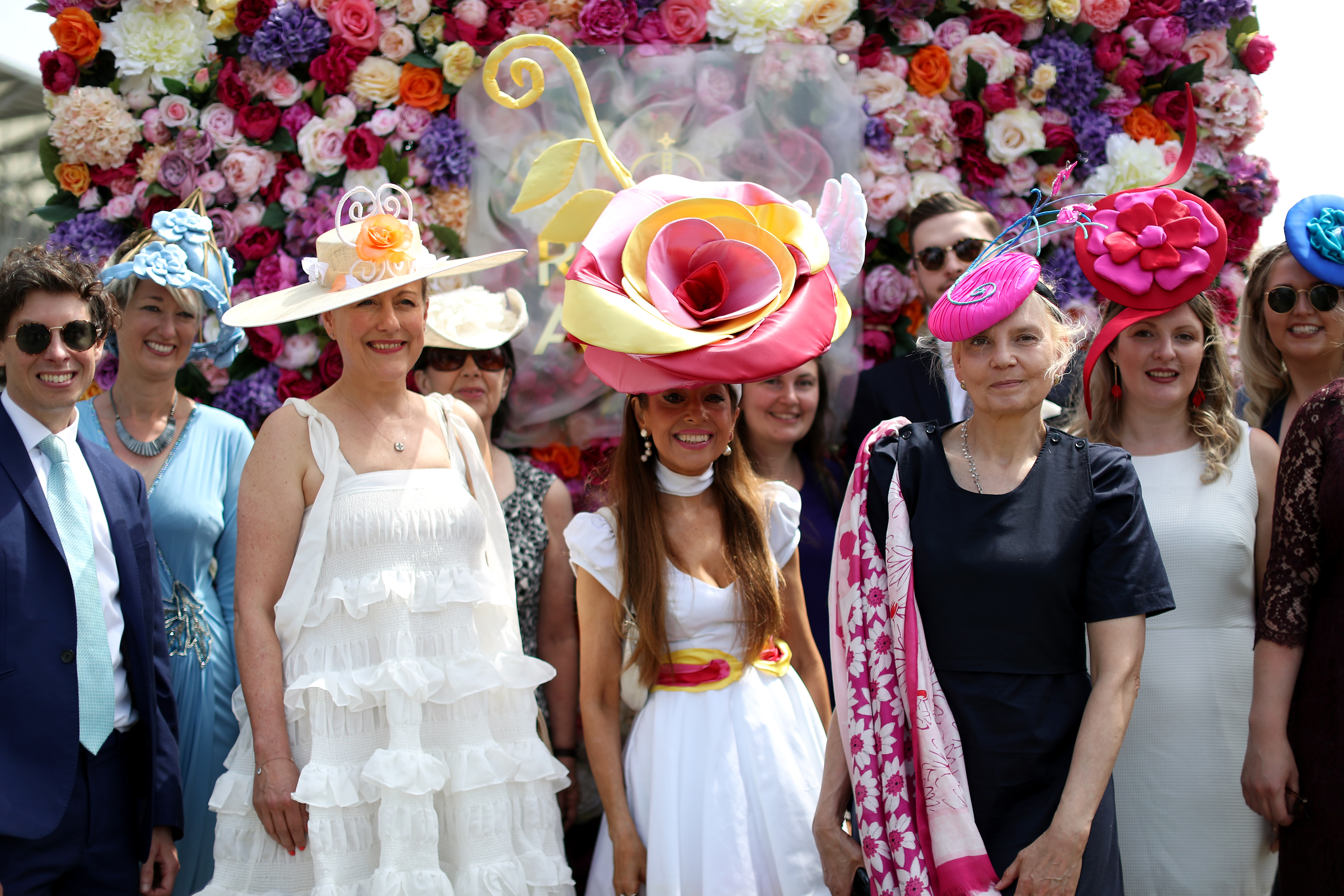<p>Racegoers including Tracy Rose (centre) pose for the picture during day one of Royal Ascot at Ascot Racecourse. Picture date: Tuesday June 15, 2021.</p>
