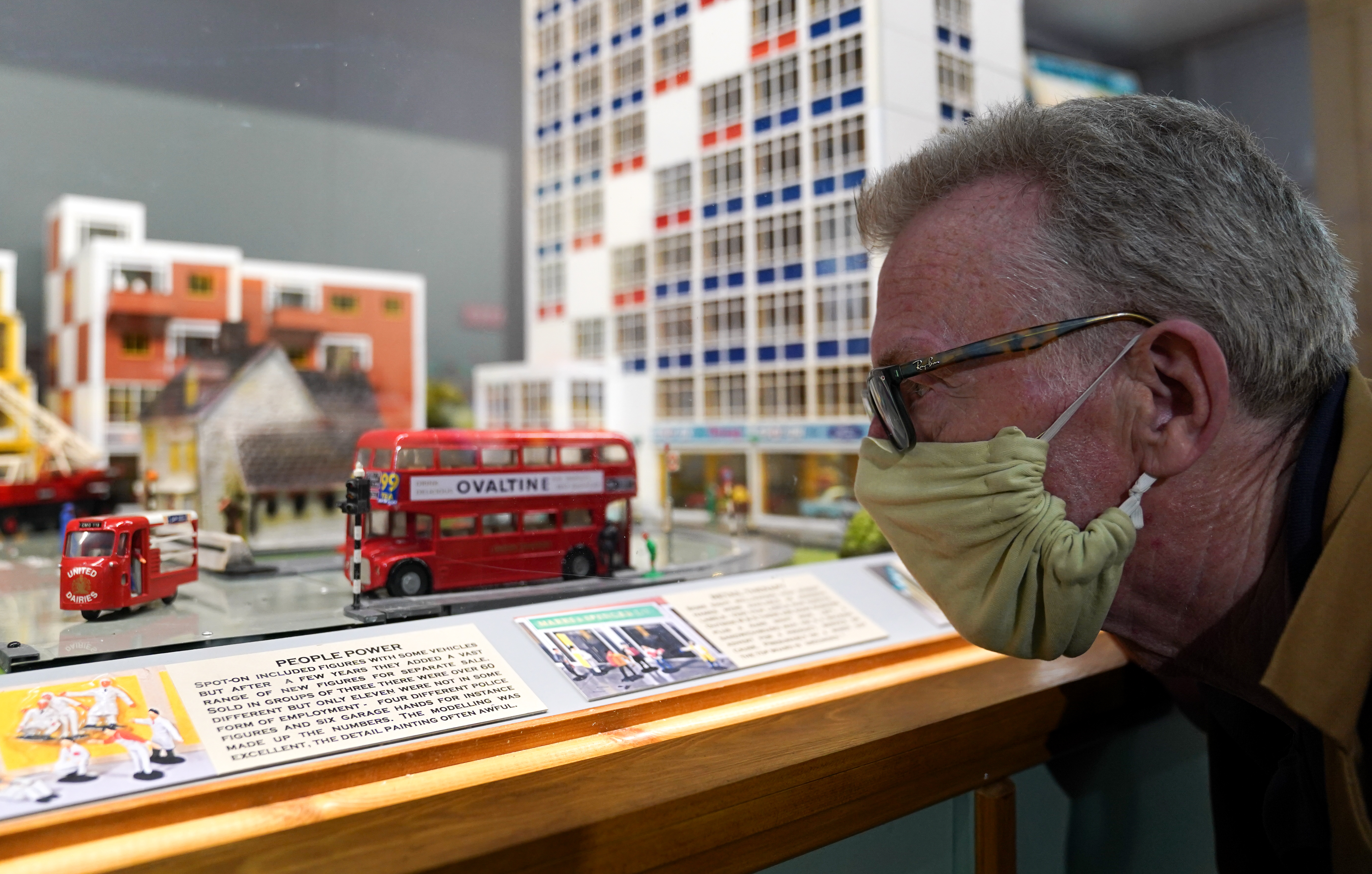 <p>Greg Hoar looks at a display case featuring Arkitex and Spot-On models during a preview for 'Life before Lego', a new exhibition of Britain's best remembered building toys, which will open to the public on June 30 at Wimborne Model Town and Gardens in Wimborne Minster, Dorset. Picture date: Wednesday June 23, 2021.</p>