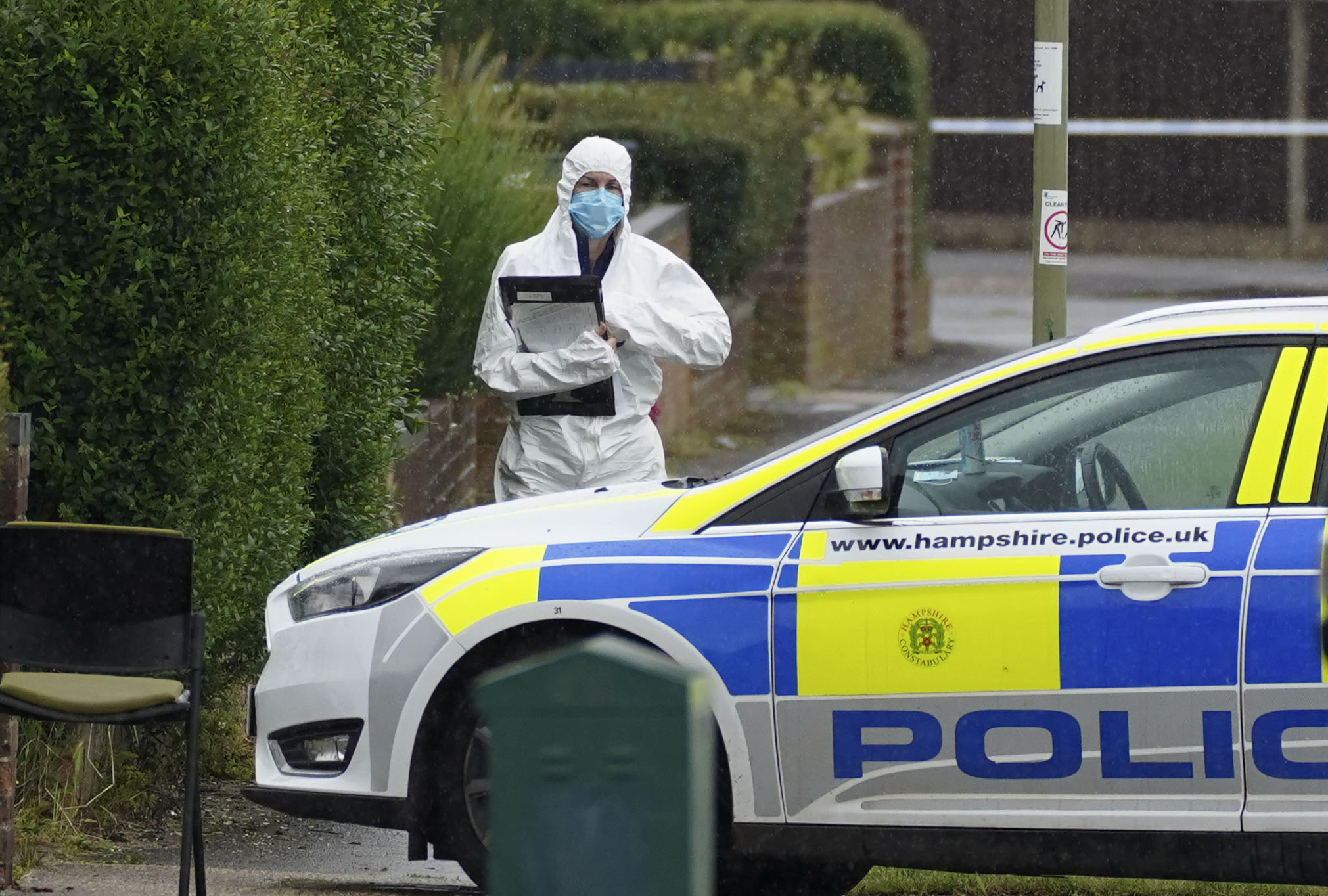 <p>Police forensics at the scene in Buckland Avenue, Basingstoke, Hampshire, after a man in his 60s and a woman in her 20s, whom had sustained serious injuries,were pronounced dead at the scene on Sunday. A 52-year-old was arrested on suspicion of murder and remains in custody. Picture date: Monday June 21, 2021.</p>