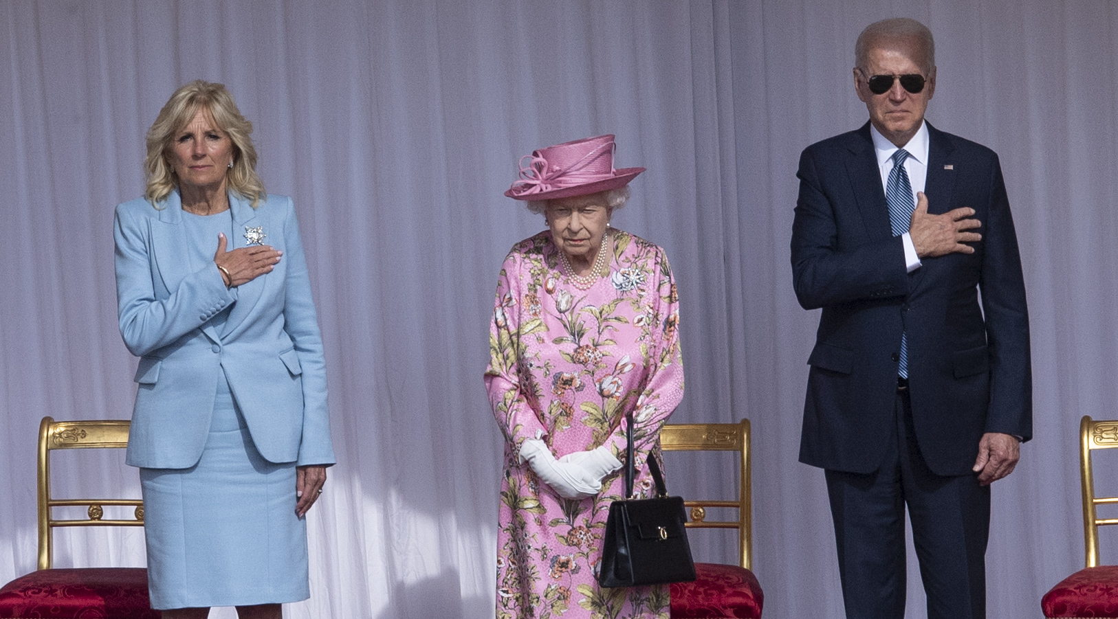 <p>WINDSOR, ENGLAND - JUNE 13:  Queen Elizabeth II with U.S. President Joe Biden and First Lady Jill Biden at Windsor Castle on June 13, 2021 in Windsor, England.  Queen Elizabeth II hosts US President, Joe Biden and First Lady Dr Jill Biden at Windsor Castle. The President arrived from Cornwall where he attended the G7 Leader's Summit and will travel on to Brussels for a meeting of NATO Allies and later in the week he will meet President of Russia, Vladimir Putin.  (Photo by UK Press Pool/UK Press via Getty Images)</p>