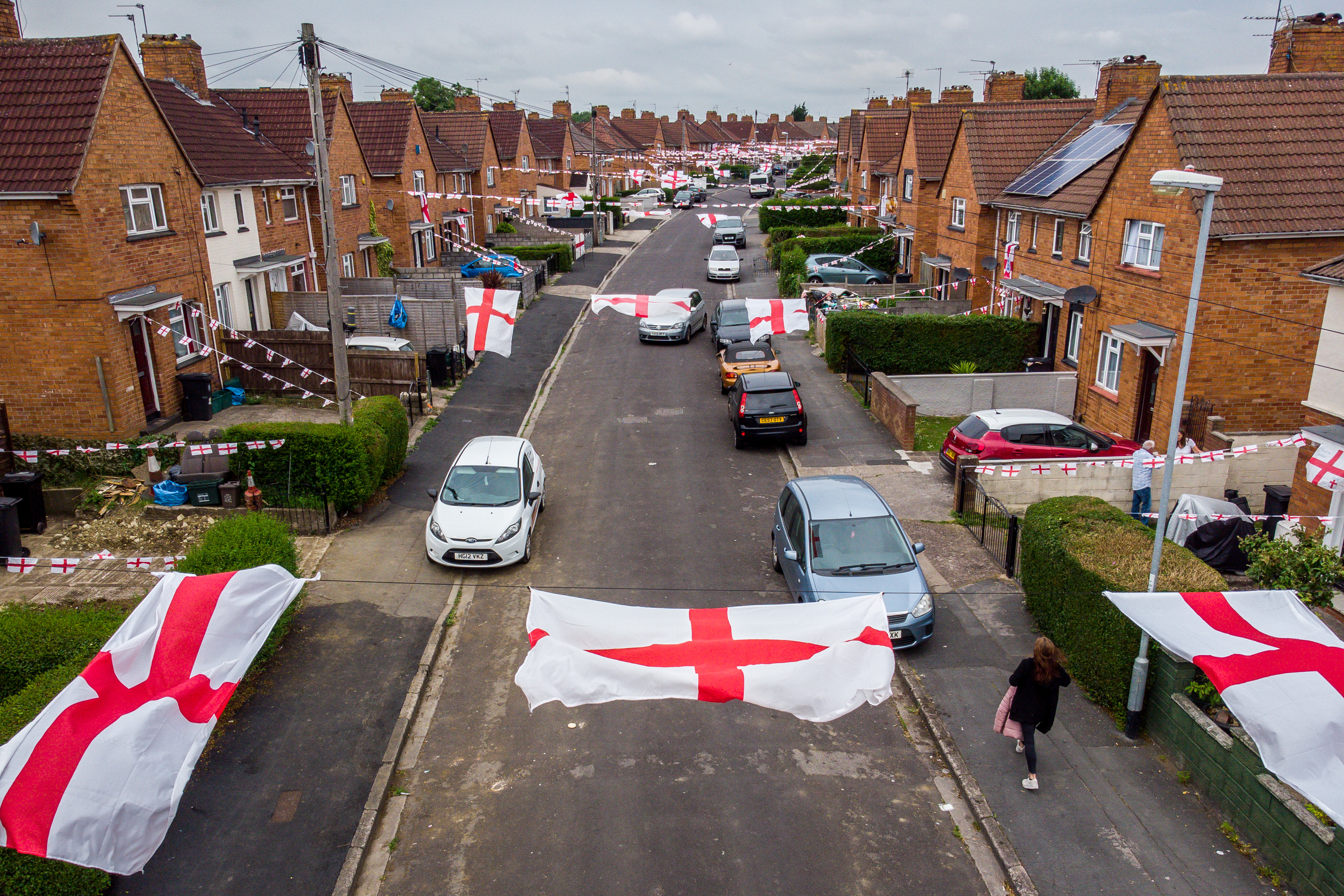 <p>England flags hang across the street in Torrington Avenue, Knowe, Bristol, where residents are showing their support for England during the Euro 2020 tournament. Picture date: Thursday June 24, 2021.</p>