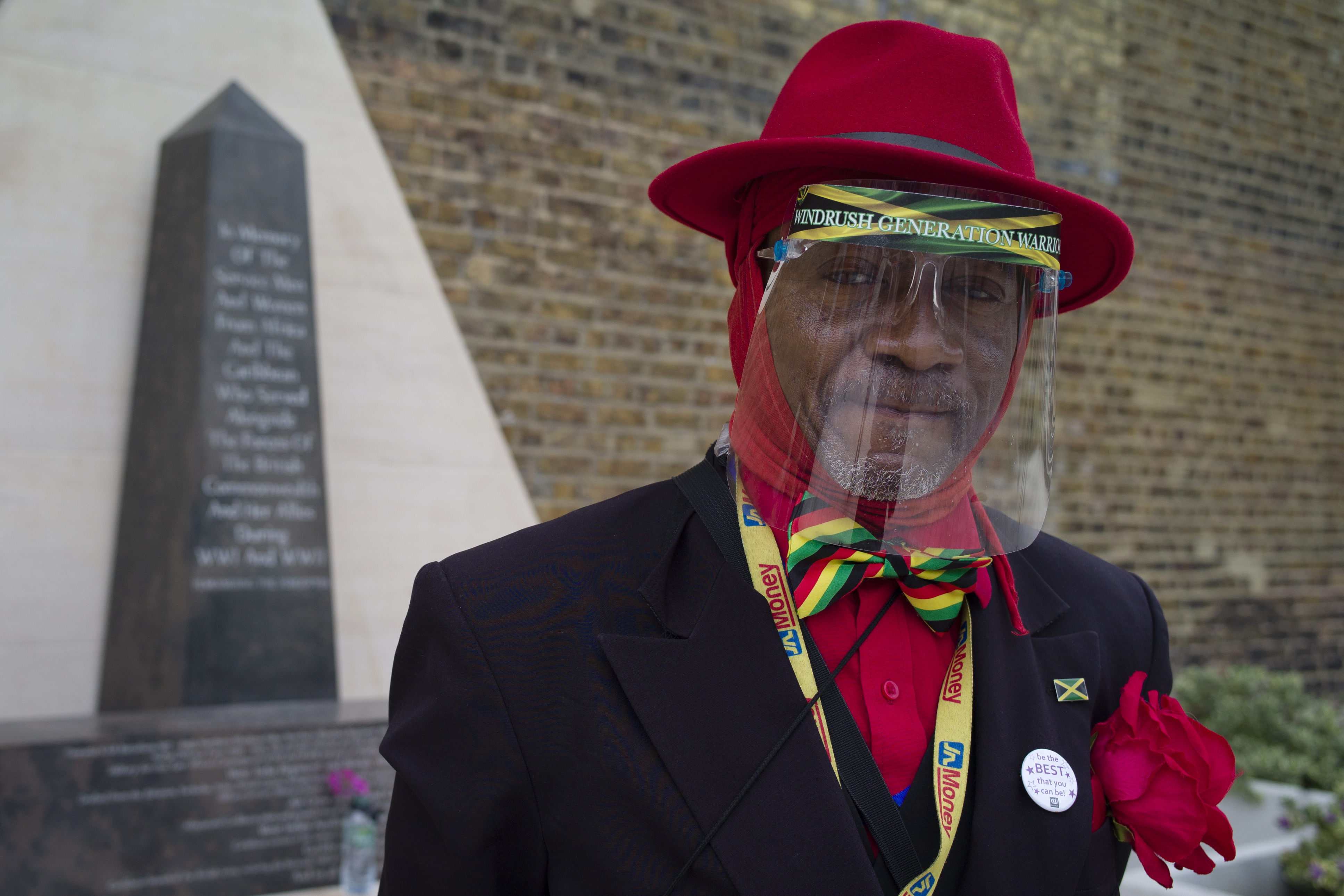 <p>LONDON, ENGLAND - JUNE 22: Elder Roger N M Mighton poses next to the memorial honoring the two million African and Caribbean military servicemen and women who served in World War I and World War II, during an event to mark Windrush Day in Windrush Square on June 22, 2021 in London, England. Windrush Day 2021 marks the 73rd anniversary of the arrival of MV Empire Windrush at the Port of Tilbury, near London, on 22 June 1948. The ship carried hundreds of people from the Caribbean who had been encouraged by the UK to come and work in the public services sector and is a seminal moment in Britain's history coming to represent the country's rich diversity. (Photo by Dan Kitwood/Getty Images)</p>