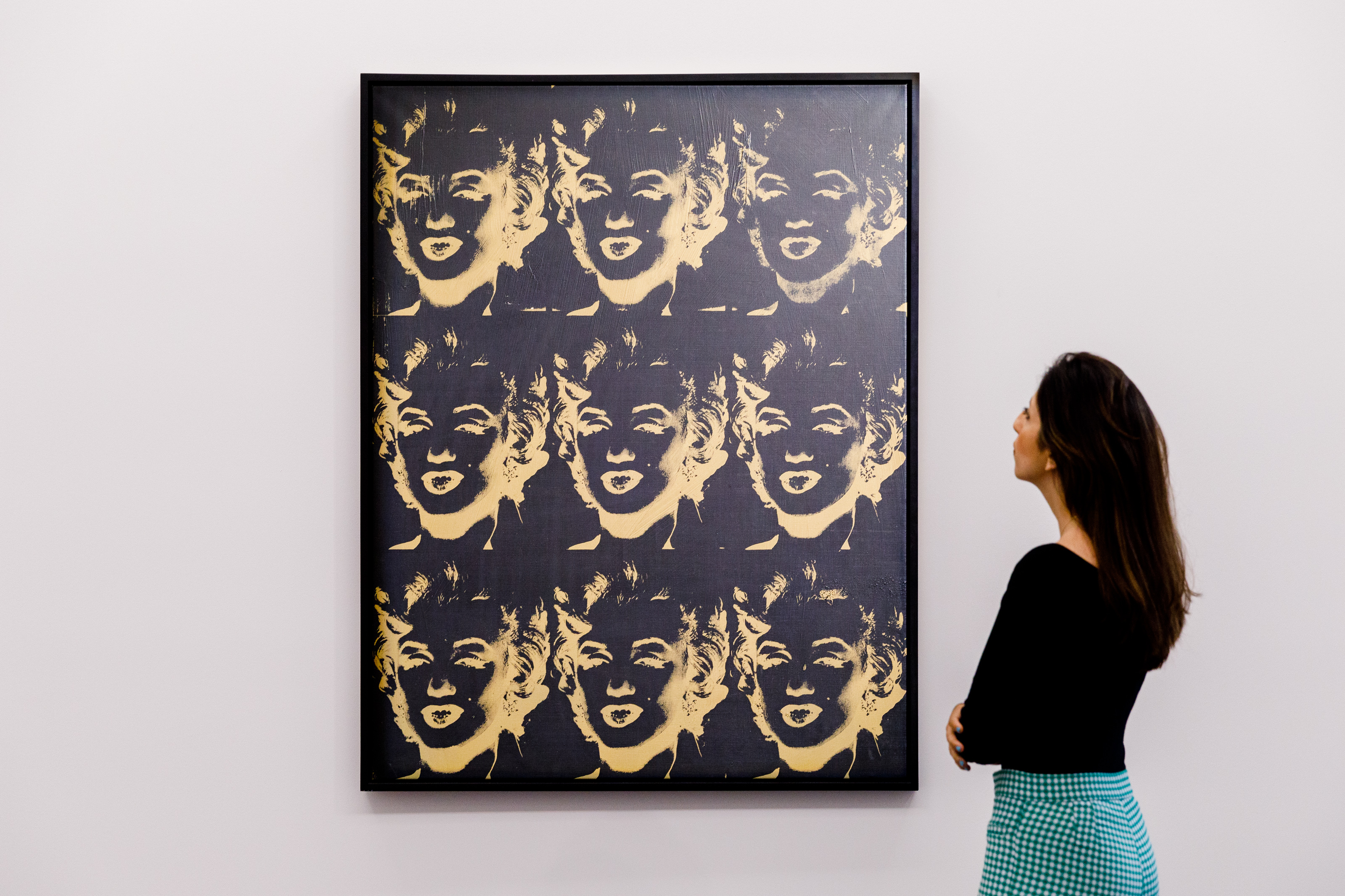 <p>LONDON, ENGLAND - JUNE 22:  Andy Warhol's '9 Gold Marilyns (Reversal Series)' (est. £5.5-8 million) goes on view at Sotheby's on June 22, 2021 in London, England. The work will be offered in the Modern &amp; Contemporary Art Evening Sale on 29th June at Sotheby's in London.(Photo by Tristan Fewings/Getty Images for Sotheby's)</p>
