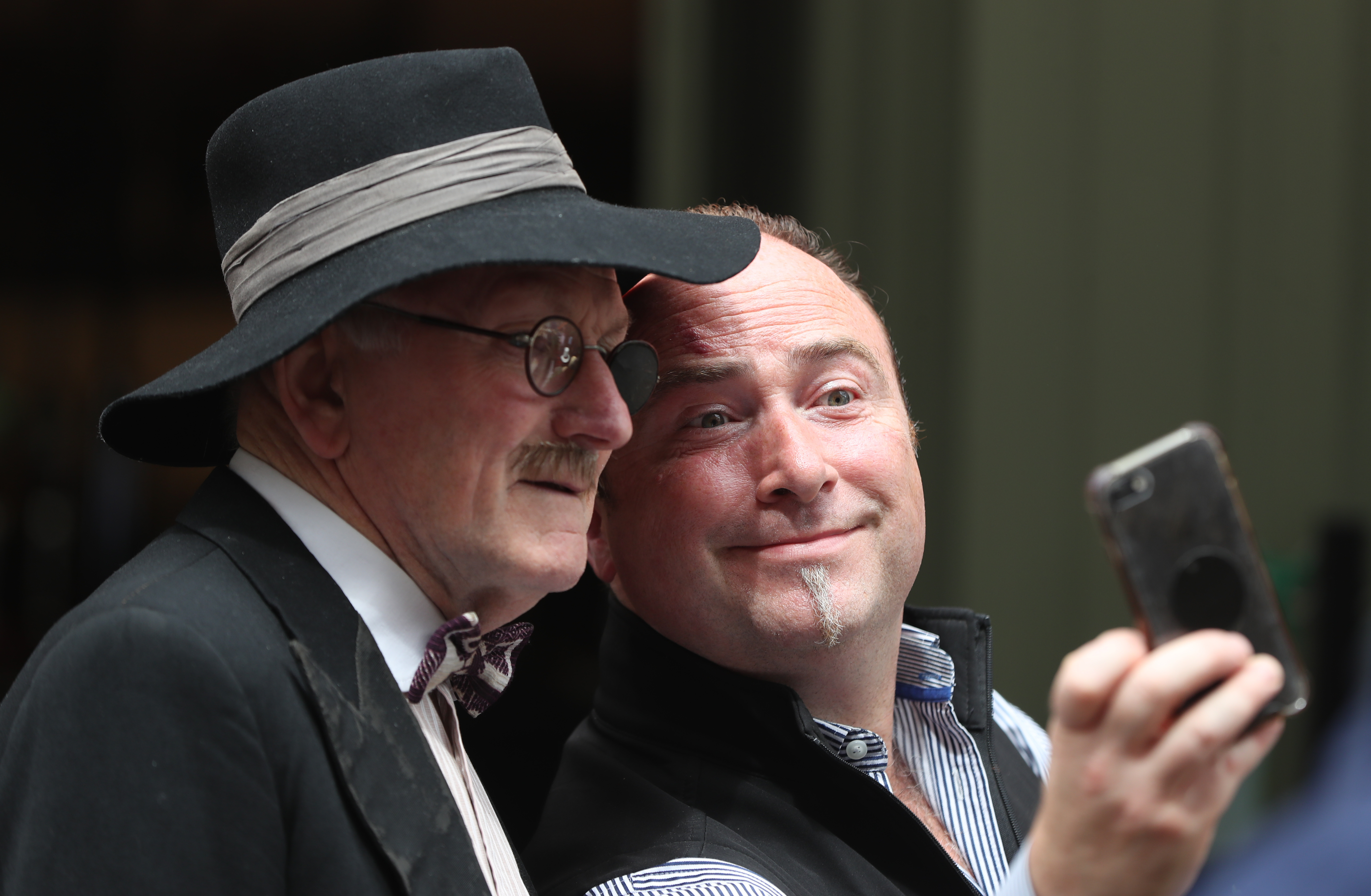 <p>A man takes a selfie with James Joyce impersonator Dermod Lynskey celebrating Bloomsday in Duke Street Dublin. Picture date: Wednesday June 16, 2021. Bloomsday is a celebration of the life of Irish writer James Joyce, observed annually worldwide on June 16, the day his 1922 novel Ulysses takes place in 1904, the date of his first outing with his wife-to-be Nora Barnacle. The day is named after its protagonist Leopold Bloom. Picture date: Wednesday June 16, 2021.</p>