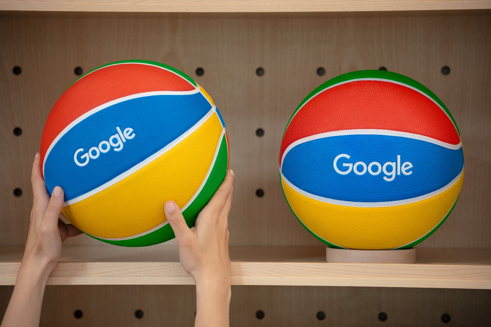 <p>Google Store Chelsea. A pair of Google-branded basketballs on a store shelf.</p>